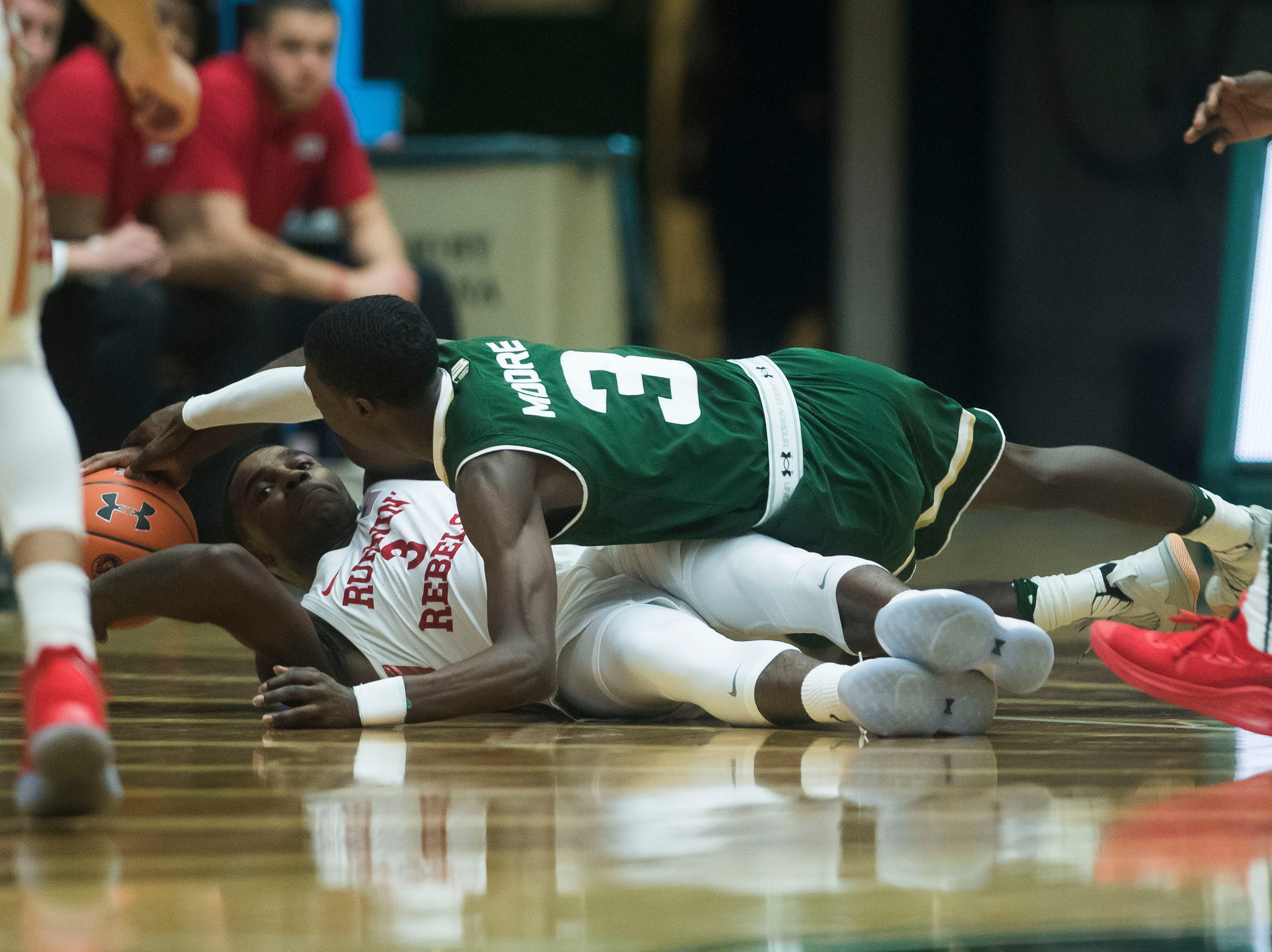 Colorado State University freshman guard Kendle Moore (3) attempts to get a loose ball from University of Nevada Las Vegas sophomore guard Amauri Hardy (3) on Saturday, March 9, 2019, at Moby Arena in Fort Collins, Colo.