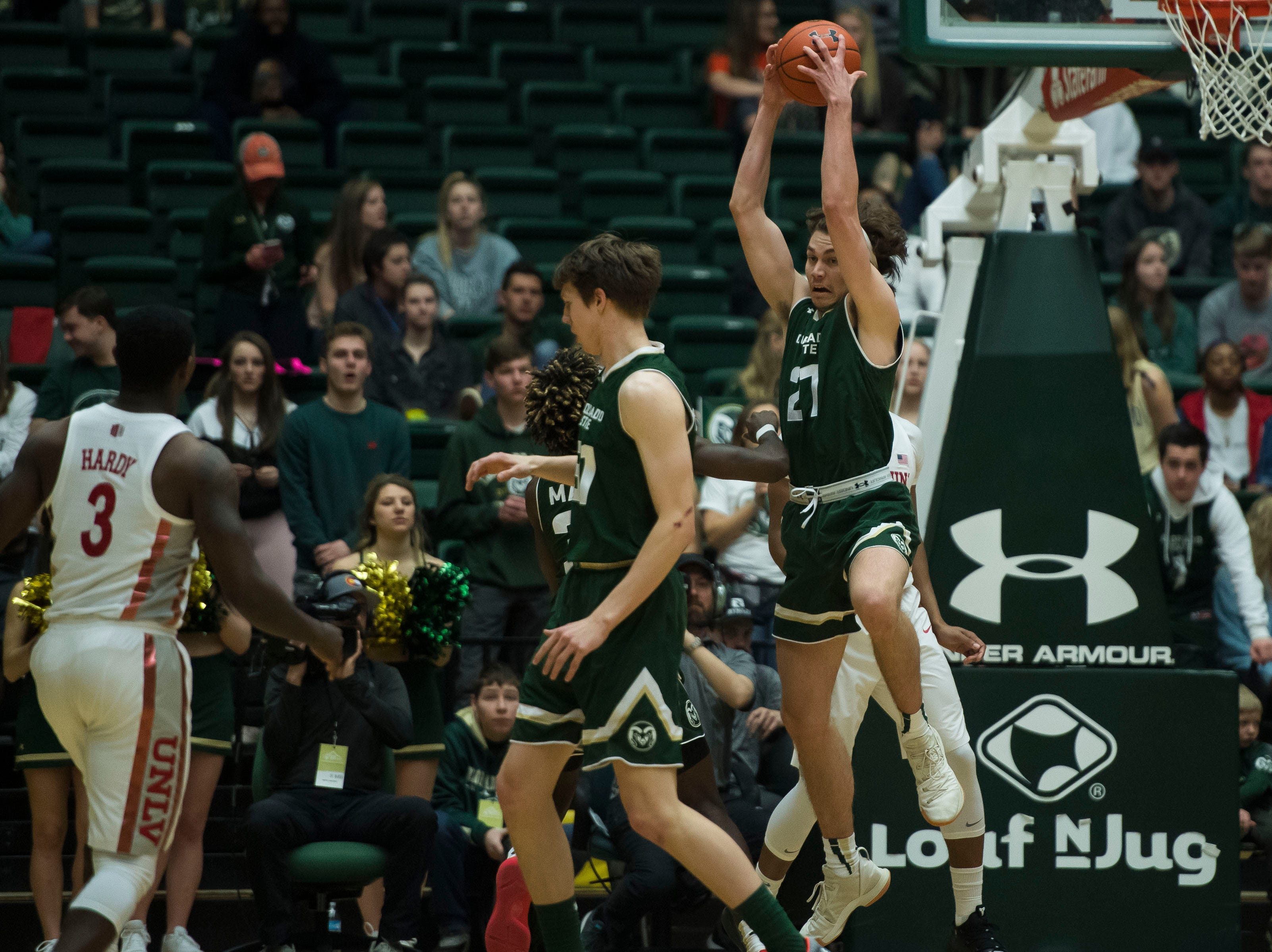 Colorado State University sophomore forward Logan Ryan (21) snags a pass from University of Nevada Las Vegas players on Saturday, March 9, 2019, at Moby Arena in Fort Collins, Colo.