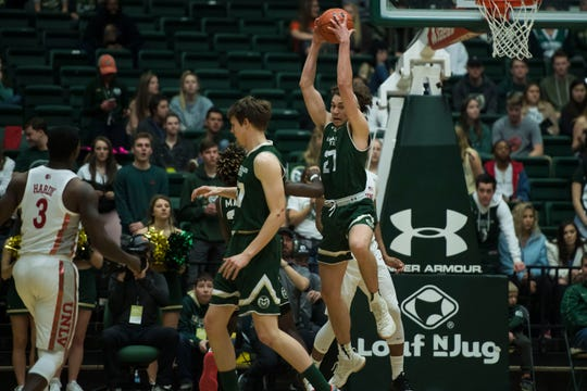 Colorado State University sophomore forward Logan Ryan (21) snags a pass from University of Nevada Las Vegas players on Saturday, March 9, 2019, at Moby Arena in Fort Collins, Colo. Ryan has said he's transferring from CSU.