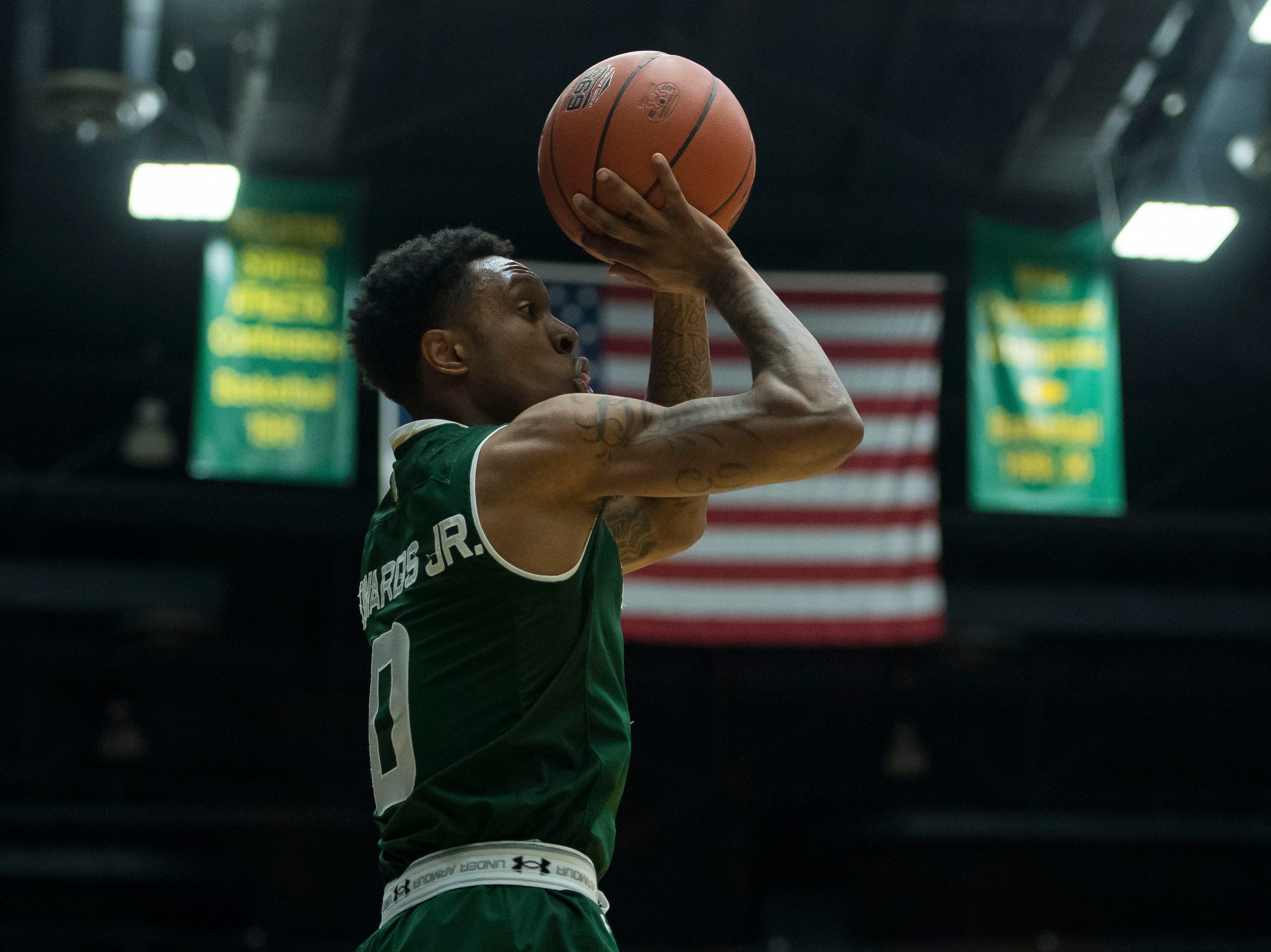 Colorado State University senior guard Hyron Edwards (0) takes a shot during a game against University of Nevada Las Vegas on Saturday, March 9, 2019, at Moby Arena in Fort Collins, Colo.