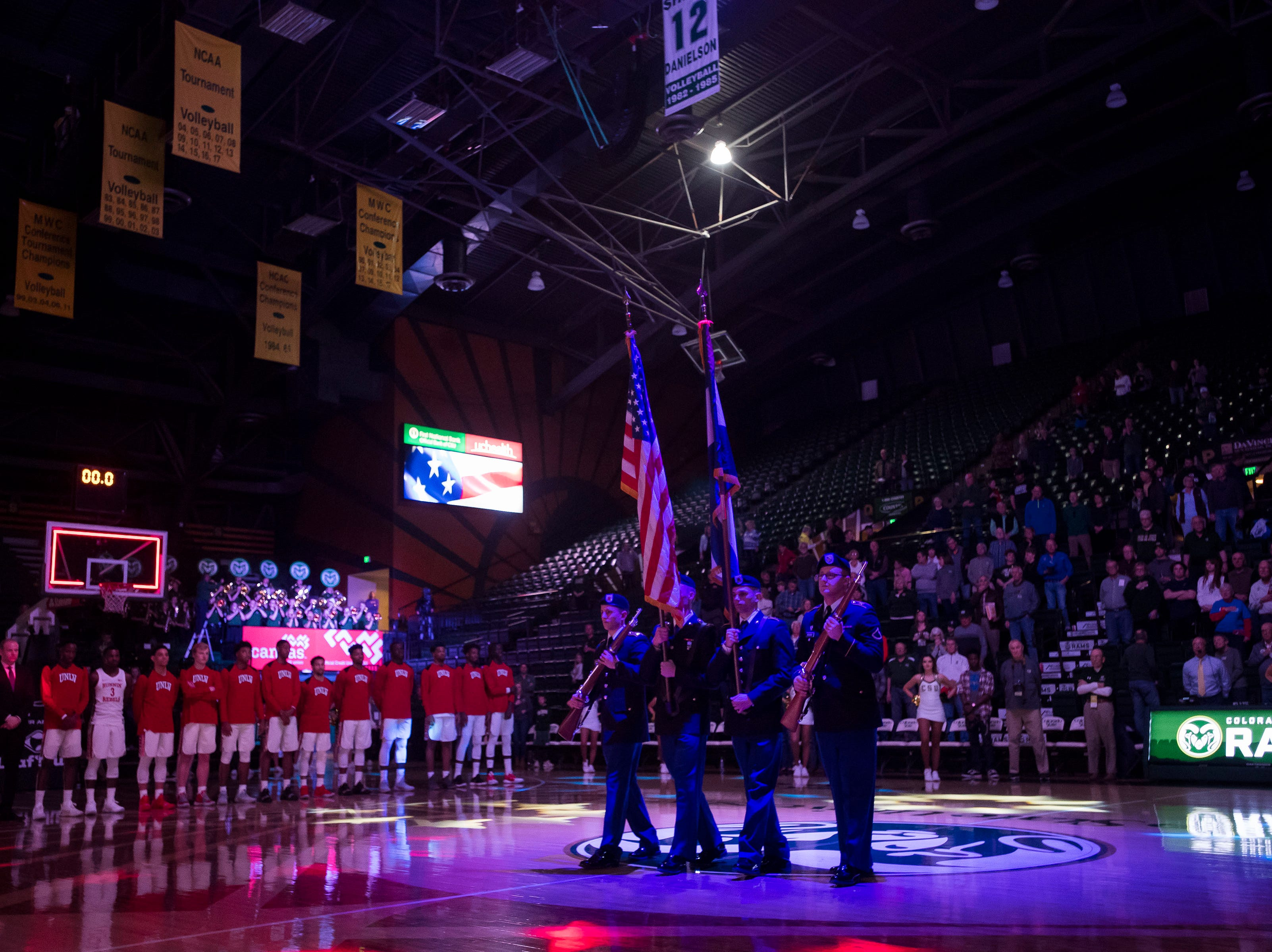 Color guards present the flags before a game between the Colorado State University and the University of Nevada Las Vegas on Saturday, March 9, 2019, at Moby Arena in Fort Collins, Colo.