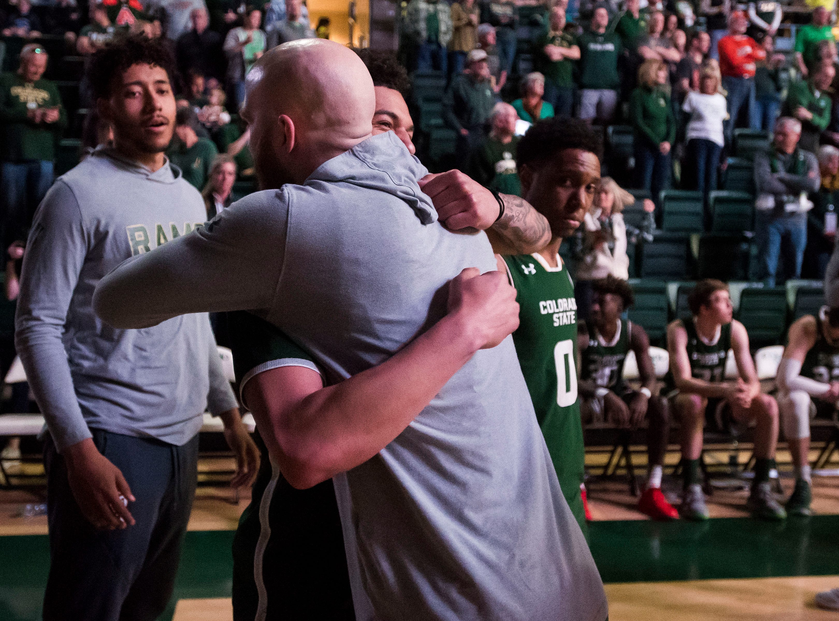Colorado State University senior guard Robbie Berwick (14) hugs junior guard Anthony Masinton-Bonner (15) before a game against University of Nevada Las Vegas on Saturday, March 9, 2019, at Moby Arena in Fort Collins, Colo.