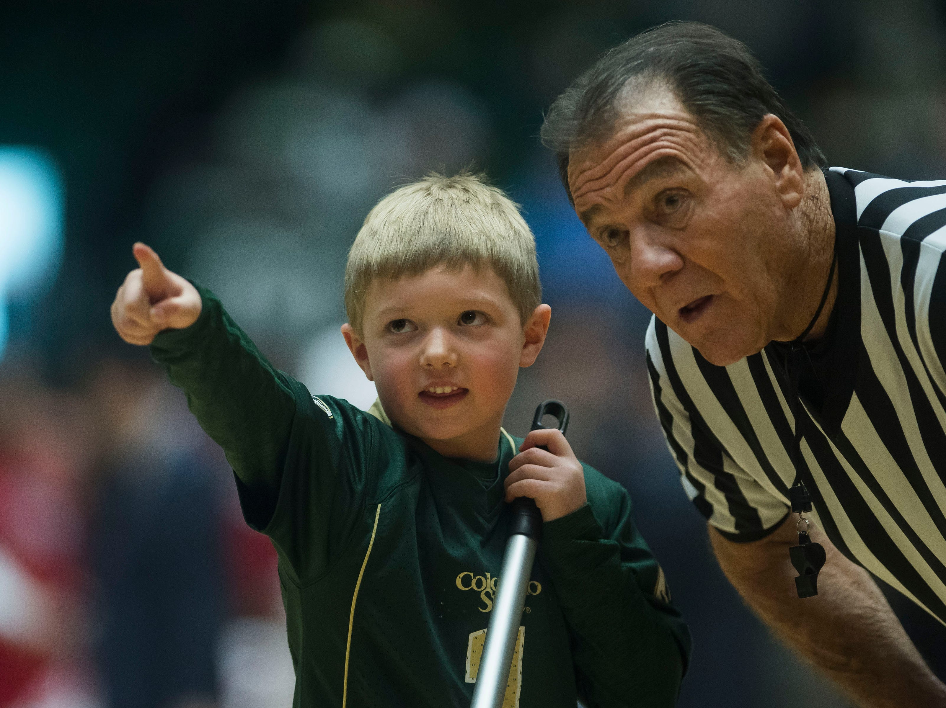An official take notice of what a mop boy points out during a game between Colorado State University and University of Nevada, Las Vegas on Saturday, March 9, 2019, at Moby Arena in Fort Collins, Colo.