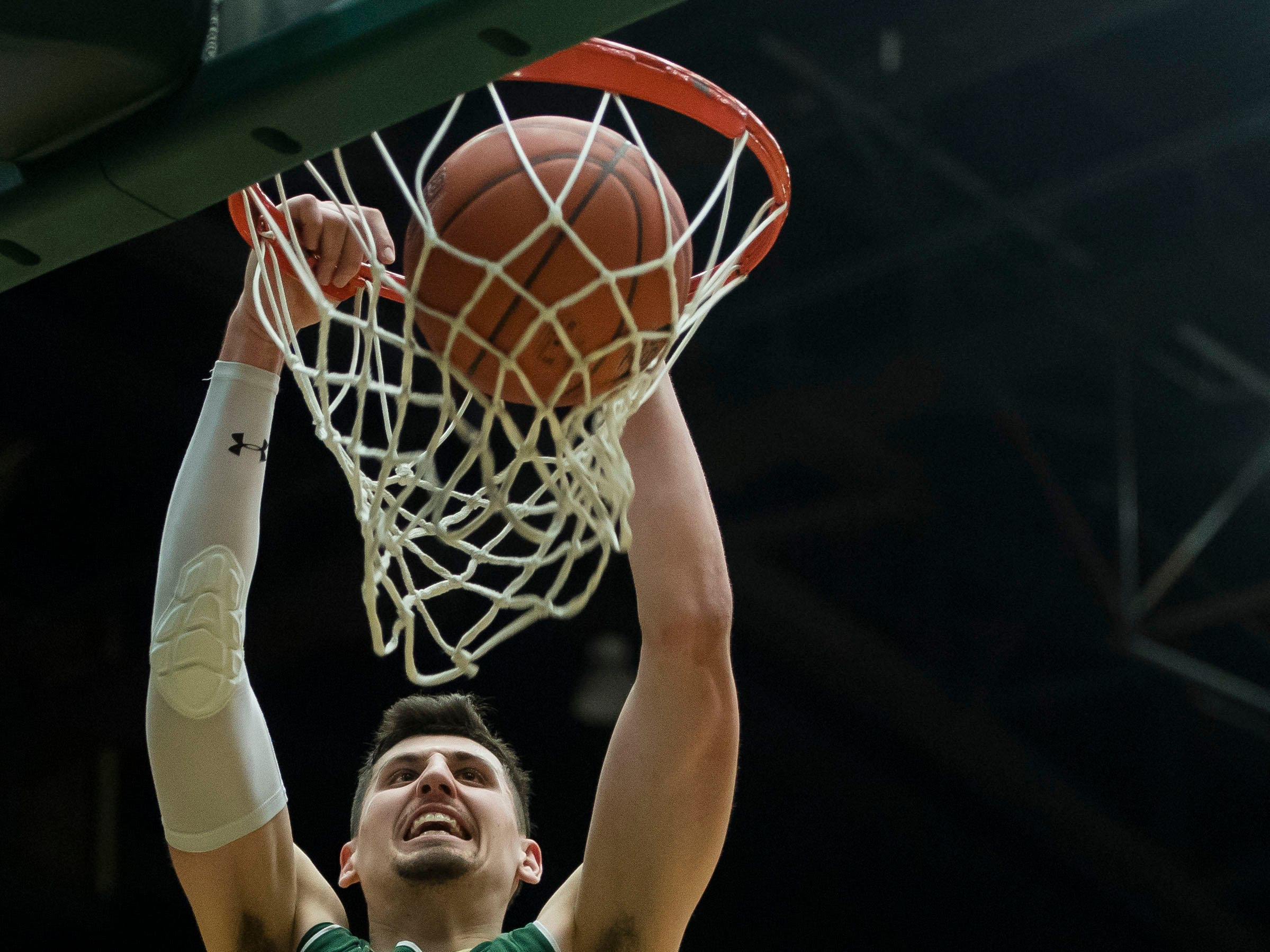 Colorado State University junior center Nico Carvacho (32) dunks during a game against University of Nevada Las Vegas on Saturday, March 9, 2019, at Moby Arena in Fort Collins, Colo.