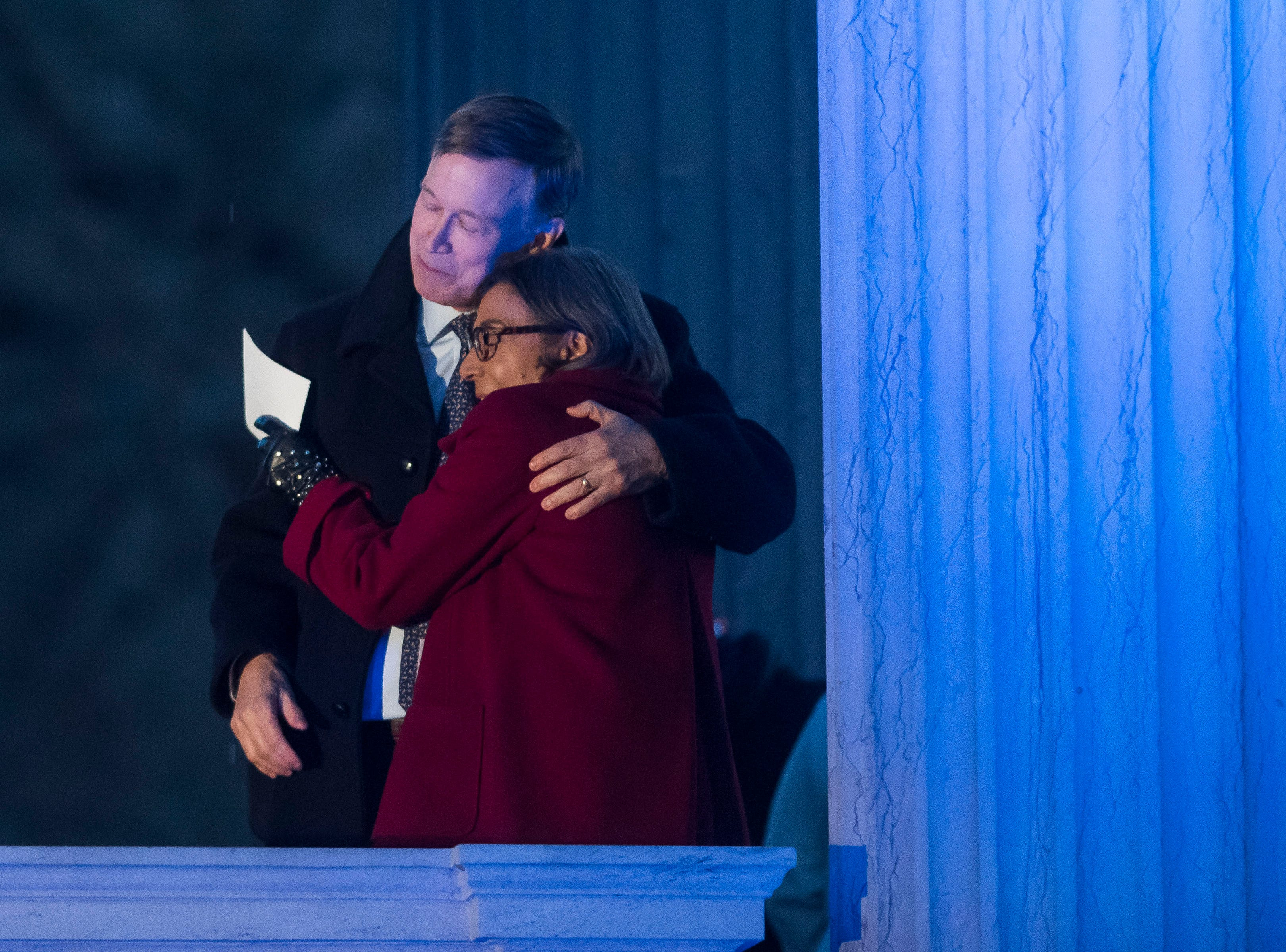 Former State Senate minority leader Reverend Lucia Guzman hugs former Colorado governor John Hickenlooper off-stage during Hickenlooper's presidential campaign kick-off rally on Thursday, March 7, 2019, at the Greek Ampitheatre in Civic Center Park in Denver, Colo.