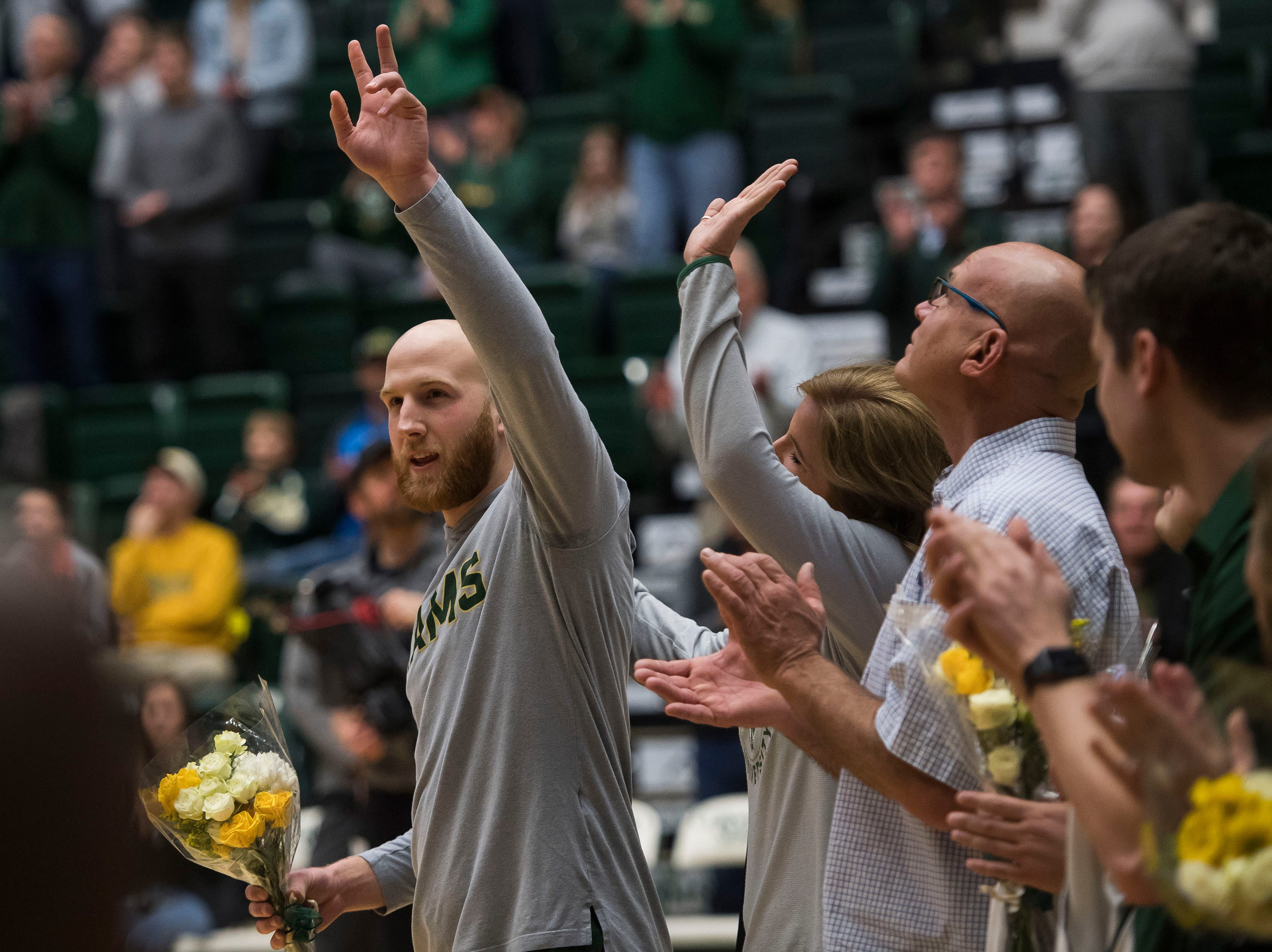 Colorado State University senior guard Robbie Berwick (14) is honored before a game against University of Nevada Las Vegas on Saturday, March 9, 2019, at Moby Arena in Fort Collins, Colo.