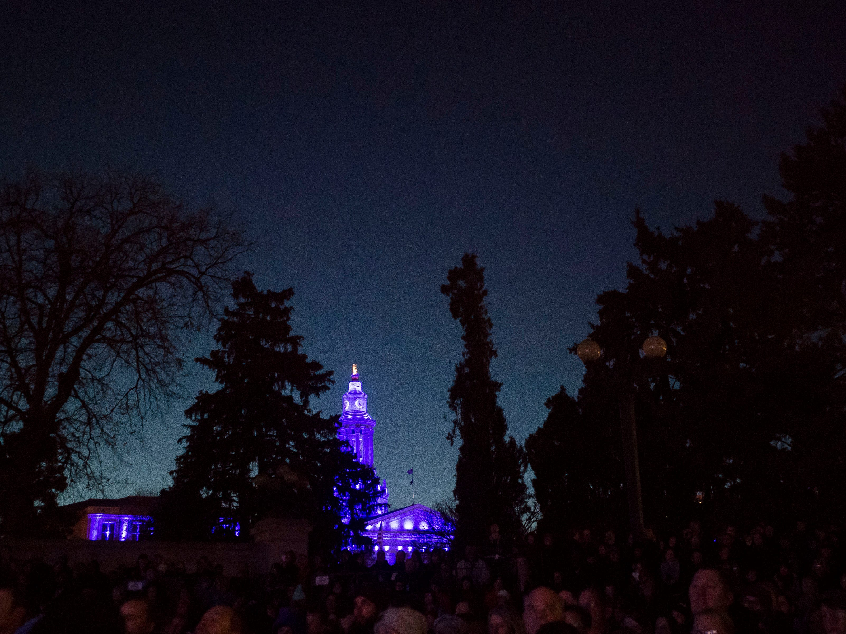 The City and County Building is lit up during former Colorado governor John Hickenlooper's presidential campaign kick-off rally on Thursday, March 7, 2019, at the Greek Ampitheatre in Civic Center Park in Denver, Colo.