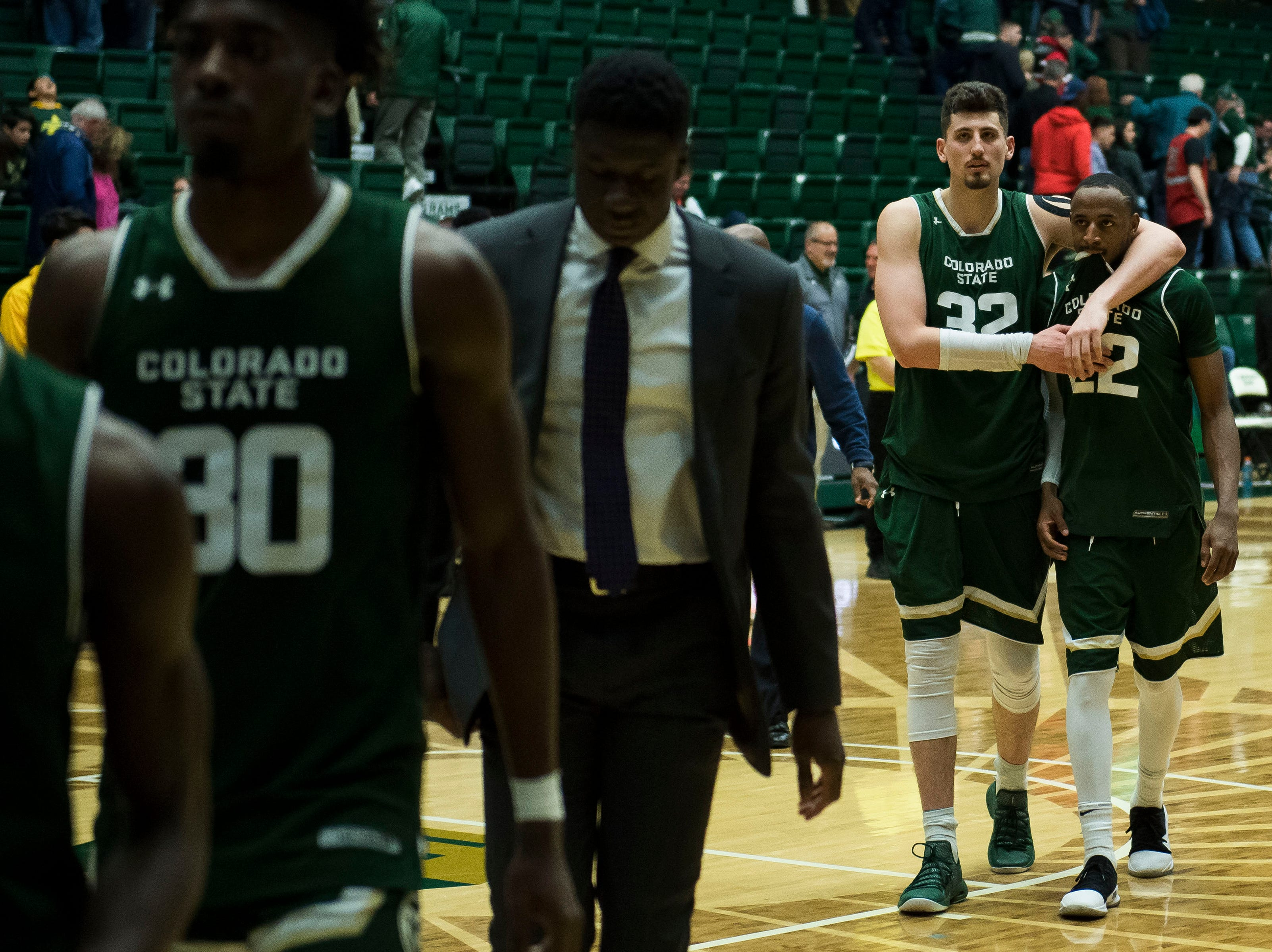 Colorado State University junior center Nico Carvacho (32) walks off court with senior guard J.D. Paige (22) after a 65-60 loss to University of Nevada, Las Vegas on Saturday, March 9, 2019, at Moby Arena in Fort Collins, Colo.