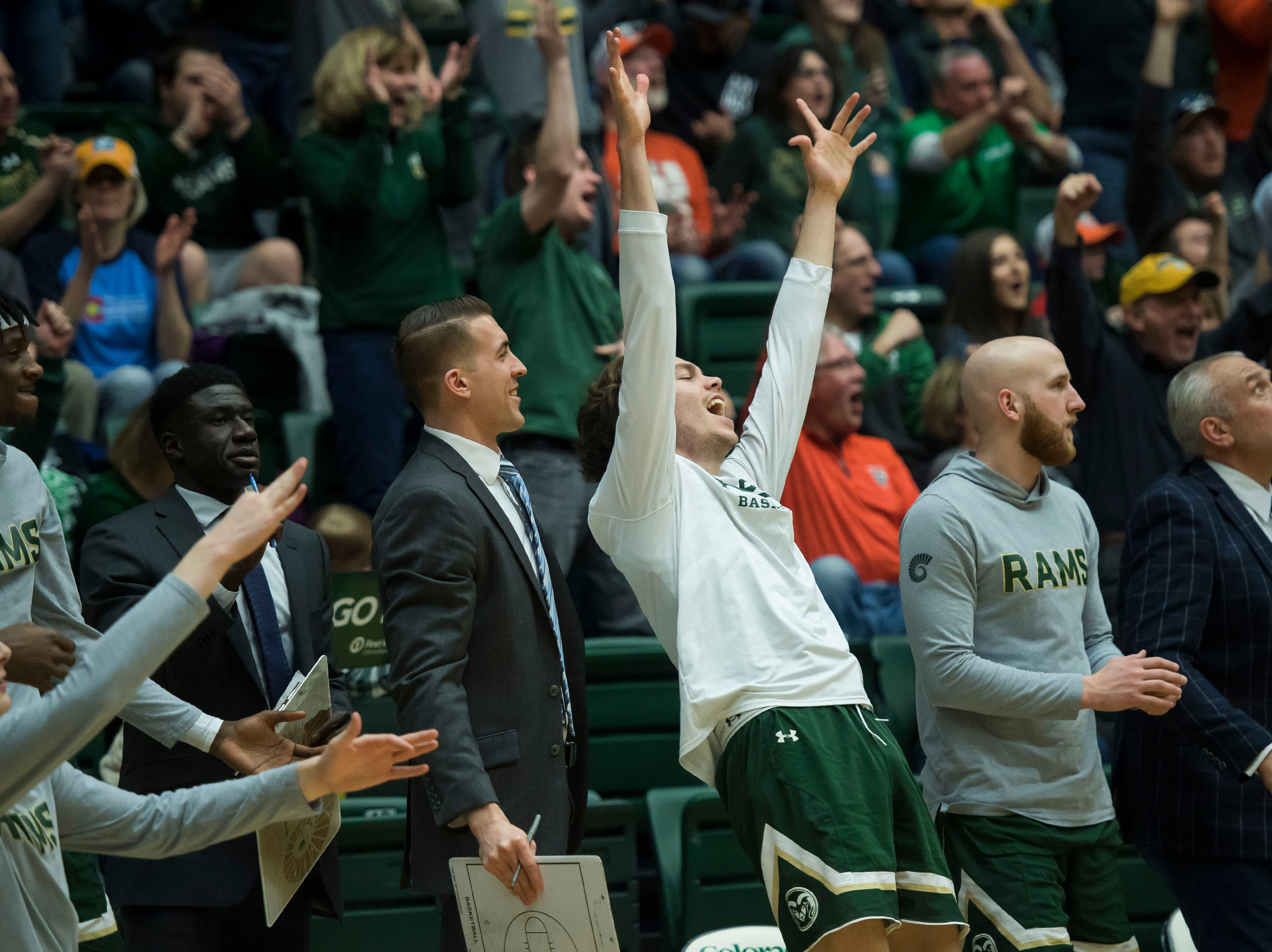 Colorado State University sophomore forward Logan Ryan (21) reacts from the bench during a game against University of Nevada, Las Vegas on Saturday, March 9, 2019, at Moby Arena in Fort Collins, Colo.
