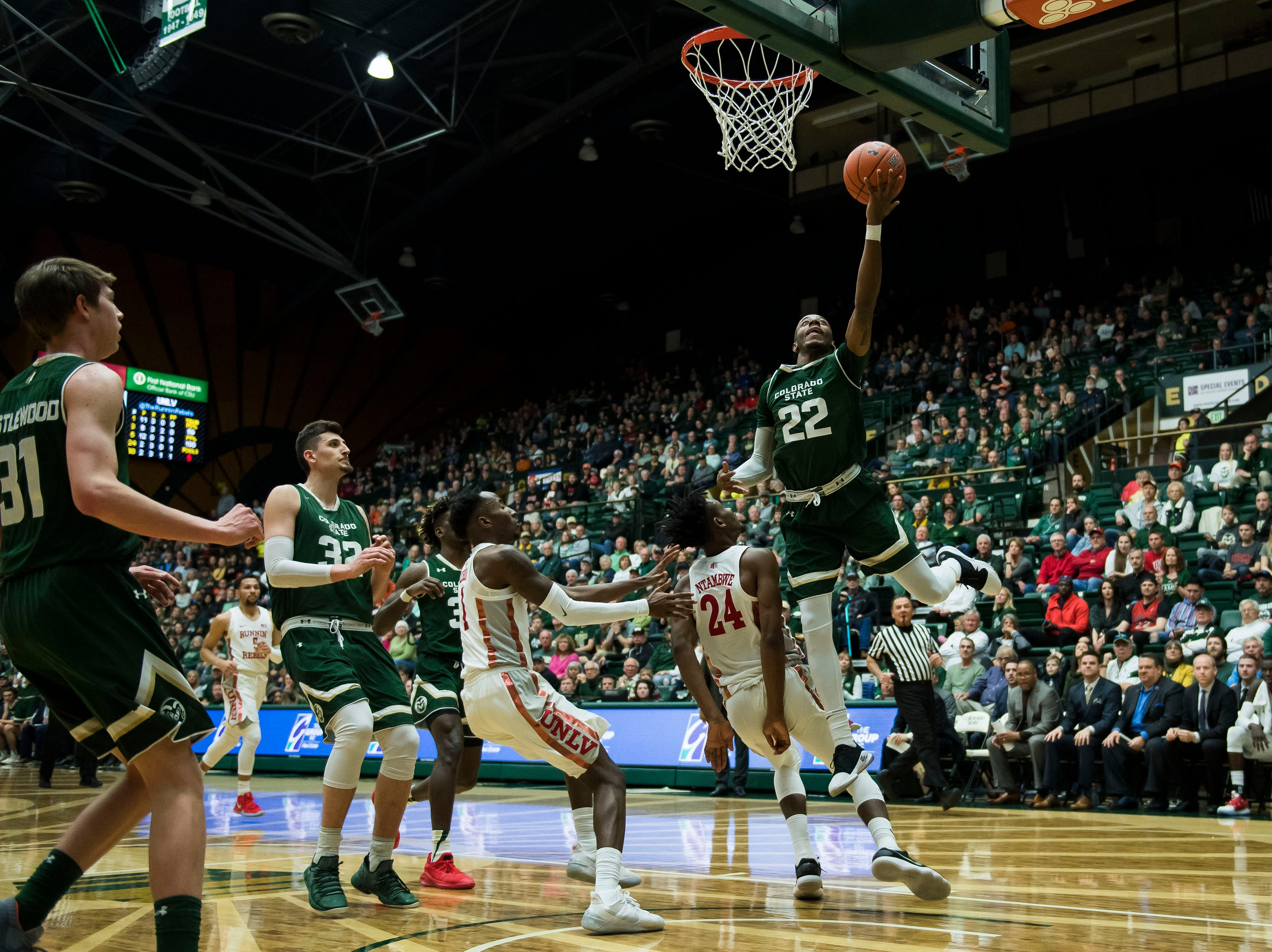 Colorado State University senior guard J.D. Paige (22) gets the layup and one during a game against University of Nevada, Las Vegas on Saturday, March 9, 2019, at Moby Arena in Fort Collins, Colo.