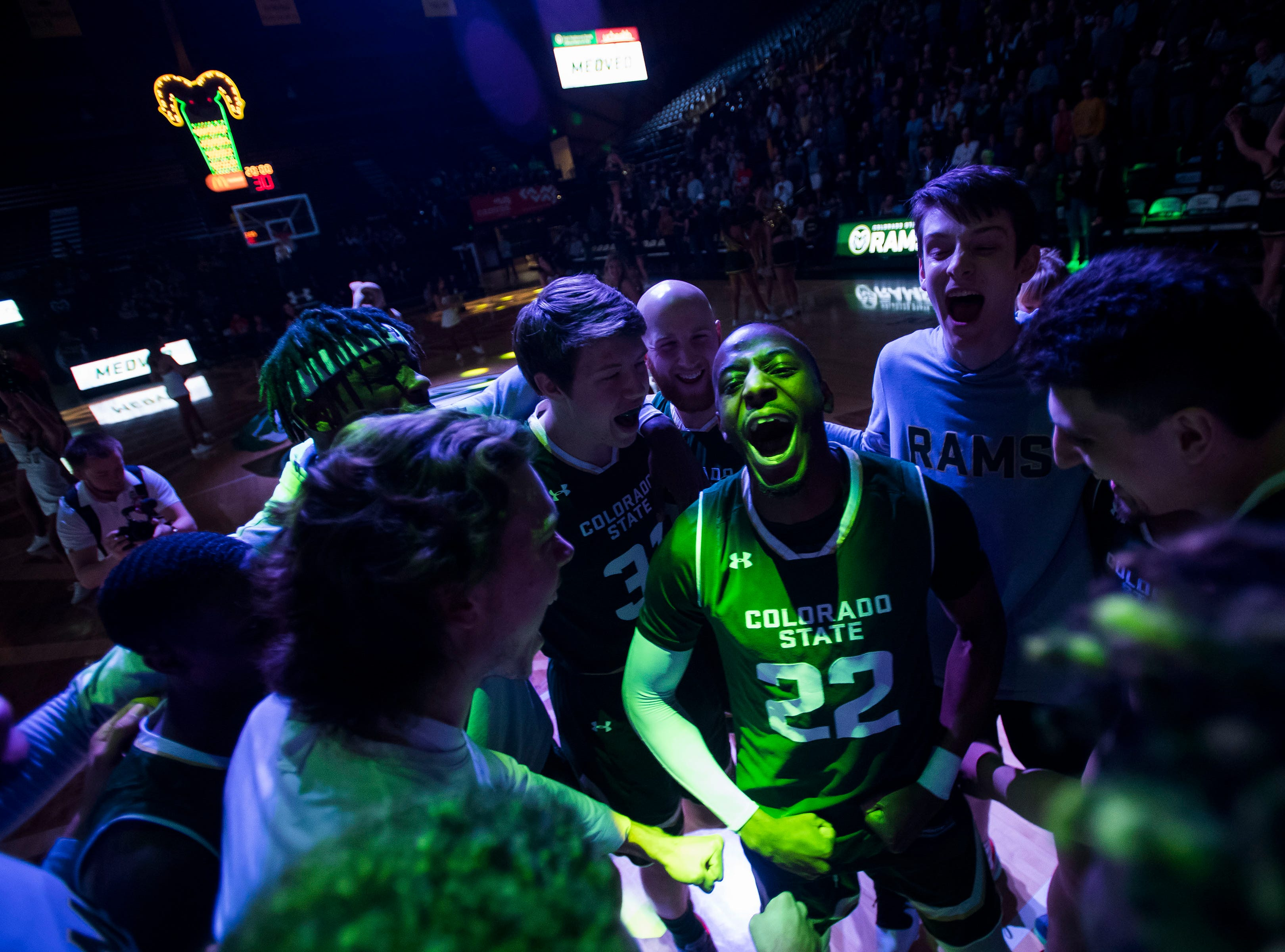 Colorado State University senior guard J.D. Paige (22) gets in the center of the huddle before a game against University of Nevada, Las Vegas on Saturday, March 9, 2019, at Moby Arena in Fort Collins, Colo.