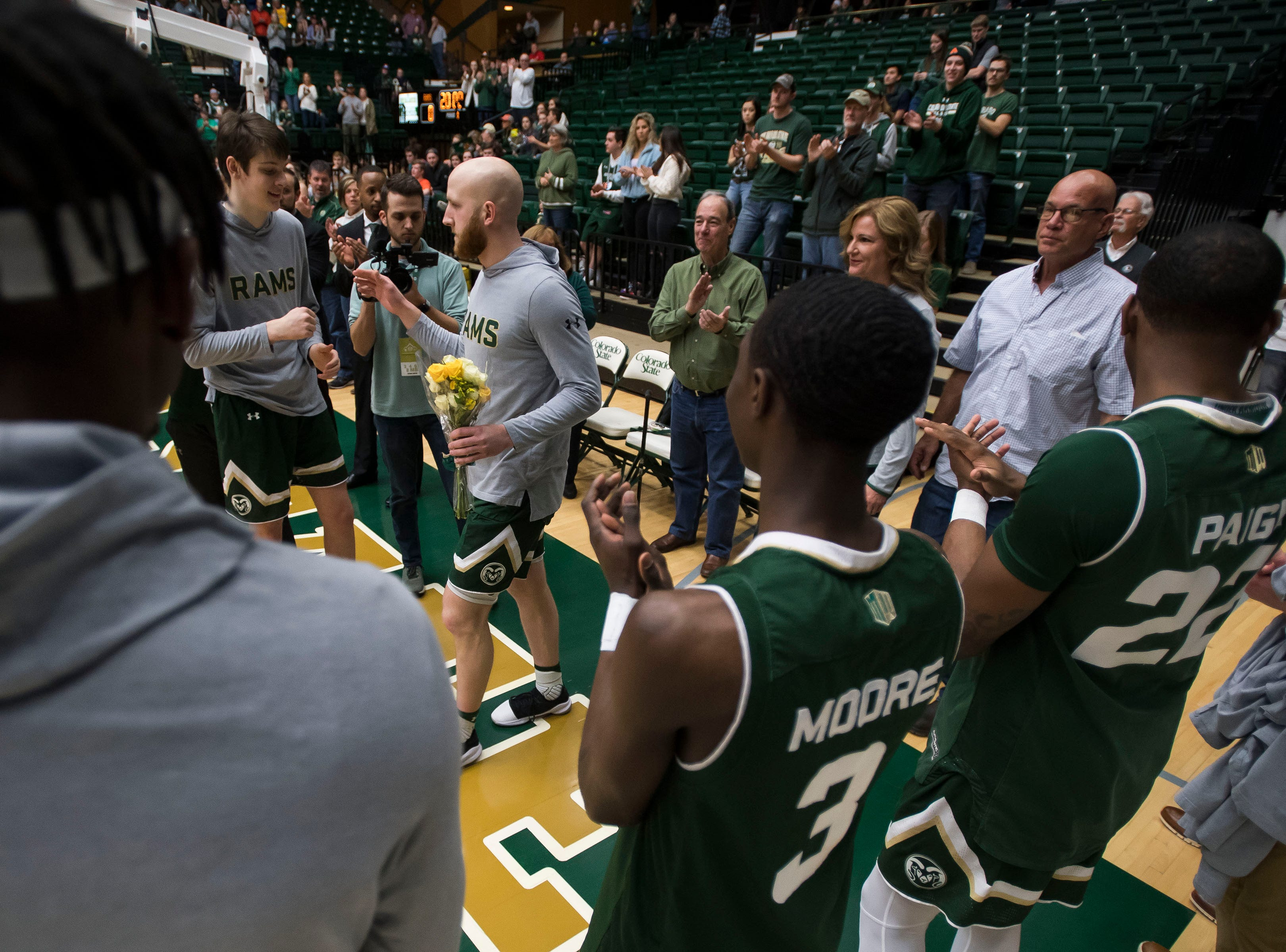 Colorado State University senior guar Robbie Berwick (14) is honored before a game against University of Nevada, Las Vegas on Saturday, March 9, 2019, at Moby Arena in Fort Collins, Colo.