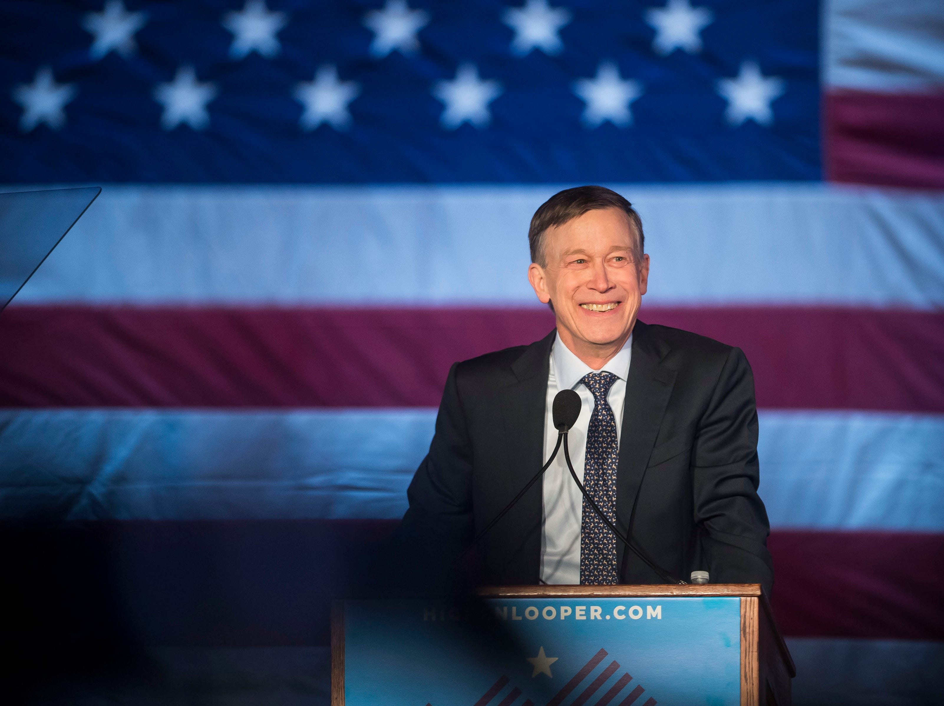 Former Colorado governor John Hickenlooper smiles before he begins his speech at his presidential campaign kick-off rally on Thursday, March 7, 2019, at the Greek Ampitheatre in Civic Center Park in Denver, Colo.