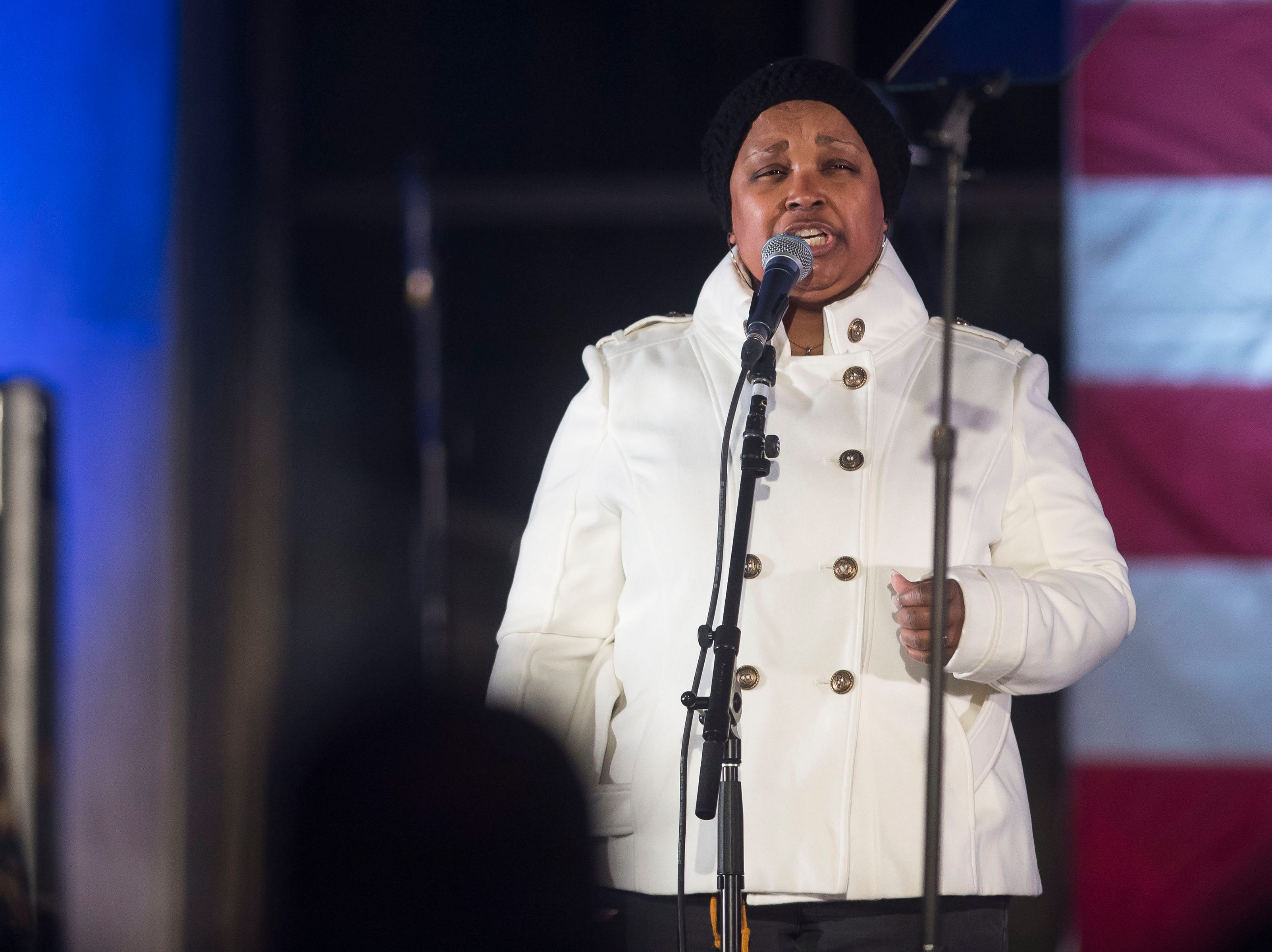 "First Lady of Denver Mary Louise Lee sings ""America the Beautiful"" during former Colorado governor John Hickenlooper's presidential campaign kick-off rally on Thursday, March 7, 2019, at the Greek Ampitheatre in Civic Center Park in Denver, Colo."