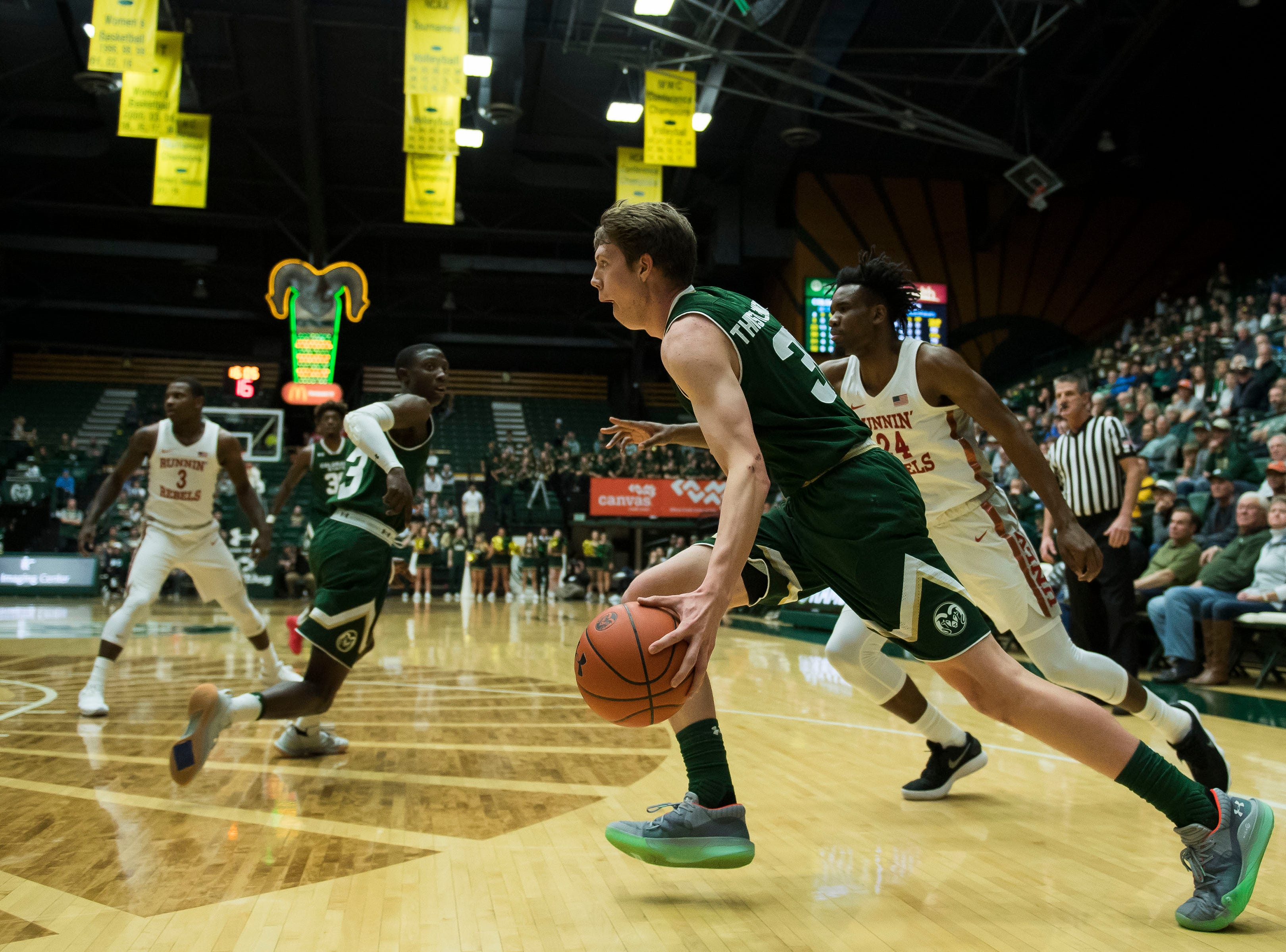 Colorado State University freshman forward Adam Thistlewood (31) drives to the basket past University of Nevada Las Vegas freshman forward Joel Ntambwe (24) on Saturday, March 9, 2019, at Moby Arena in Fort Collins, Colo.
