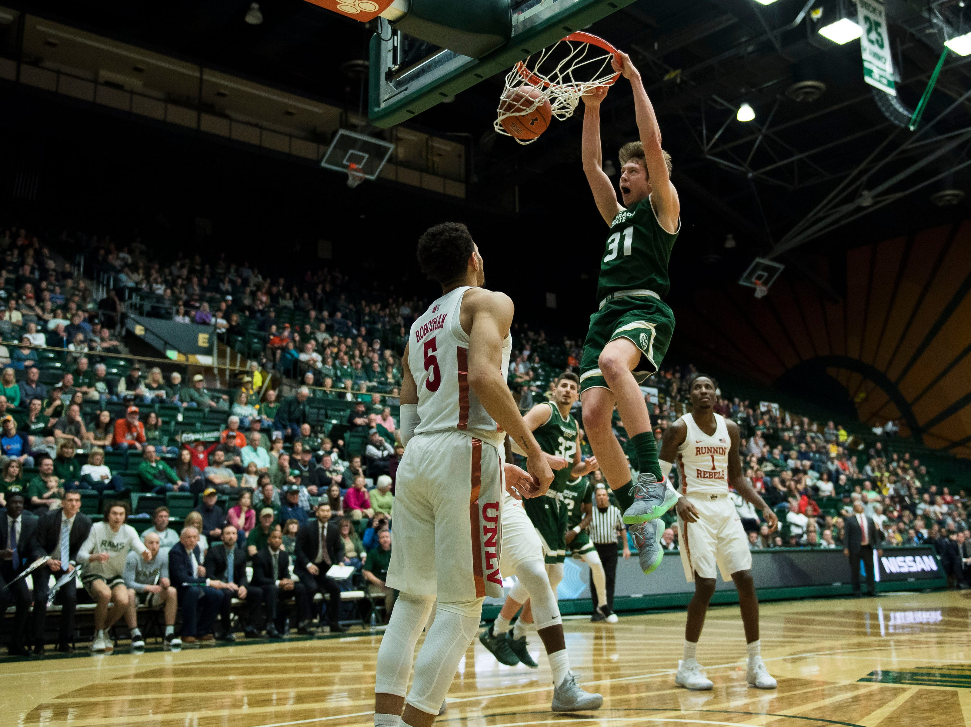 Colorado State University freshman forward Adam Thistlewood (31) dunks over University of Nevada Las Vegas senior guard Noah Robotham (5) on Saturday, March 9, 2019, at Moby Arena in Fort Collins, Colo.