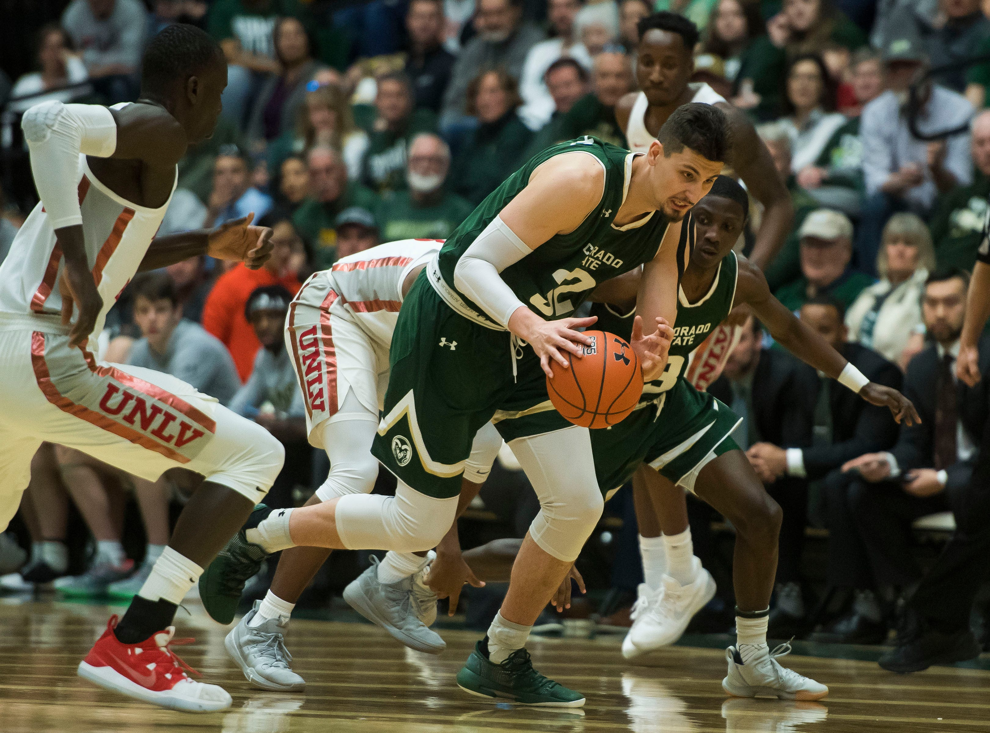 Colorado State University junior center Nico Carvacho (32) goes down-court after stealing the ball during a game against University of Nevada, Las Vegas on Saturday, March 9, 2019, at Moby Arena in Fort Collins, Colo.