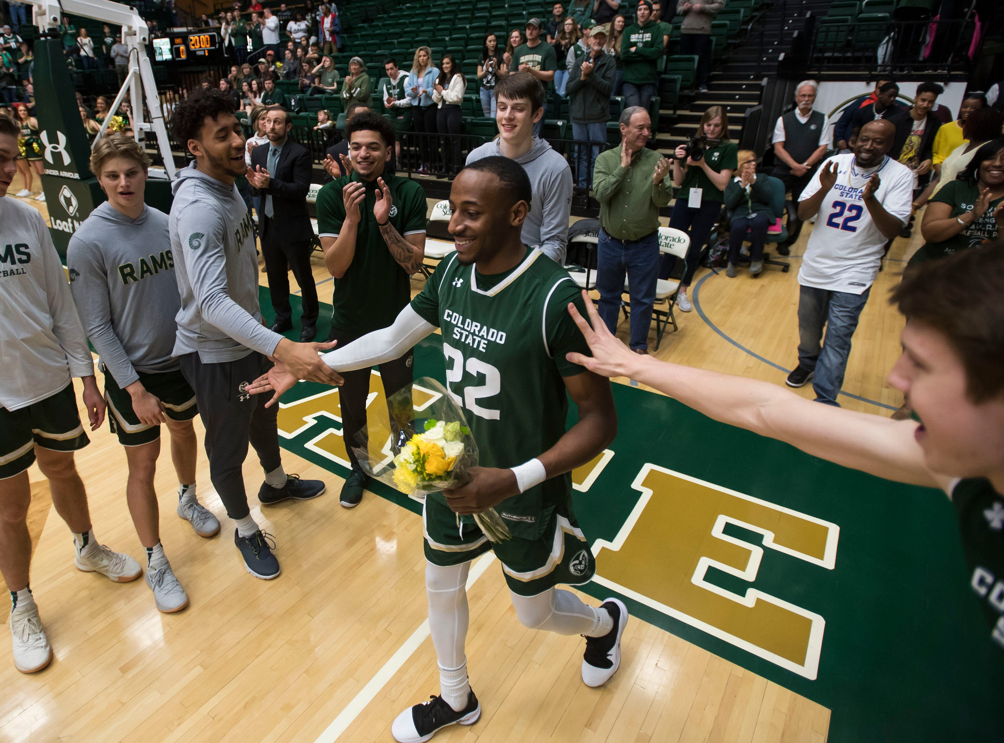 Colorado State University senior guard J.D. Paige (22) is honored before a game against University of Nevada, Las Vegas on Saturday, March 9, 2019, at Moby Arena in Fort Collins, Colo.