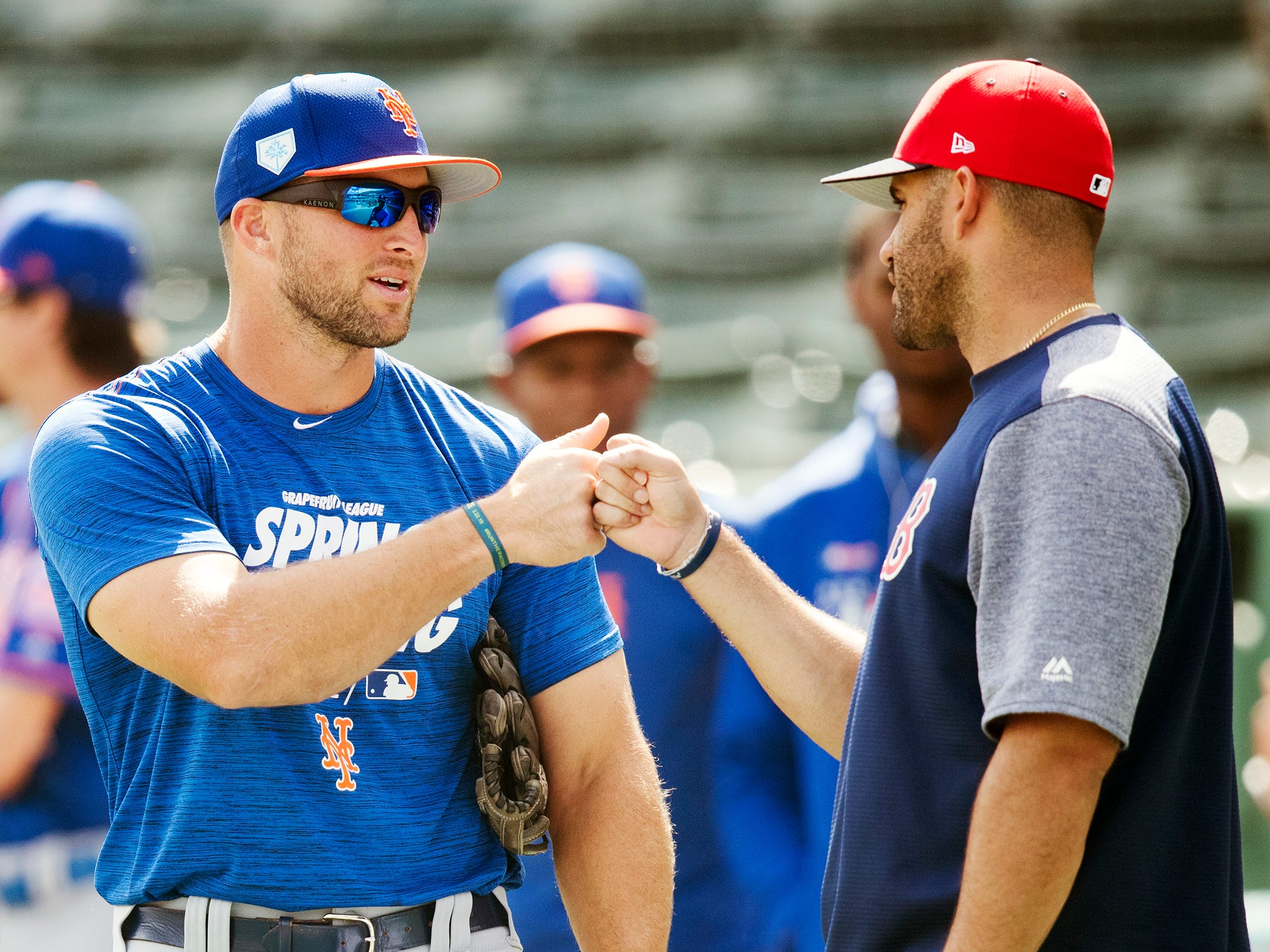 New York Mets' Tim Tebow, left, and Boston Red Sox J.D. Martinez relax before their spring training game on Saturday at JetBlue Park in Fort Myers.