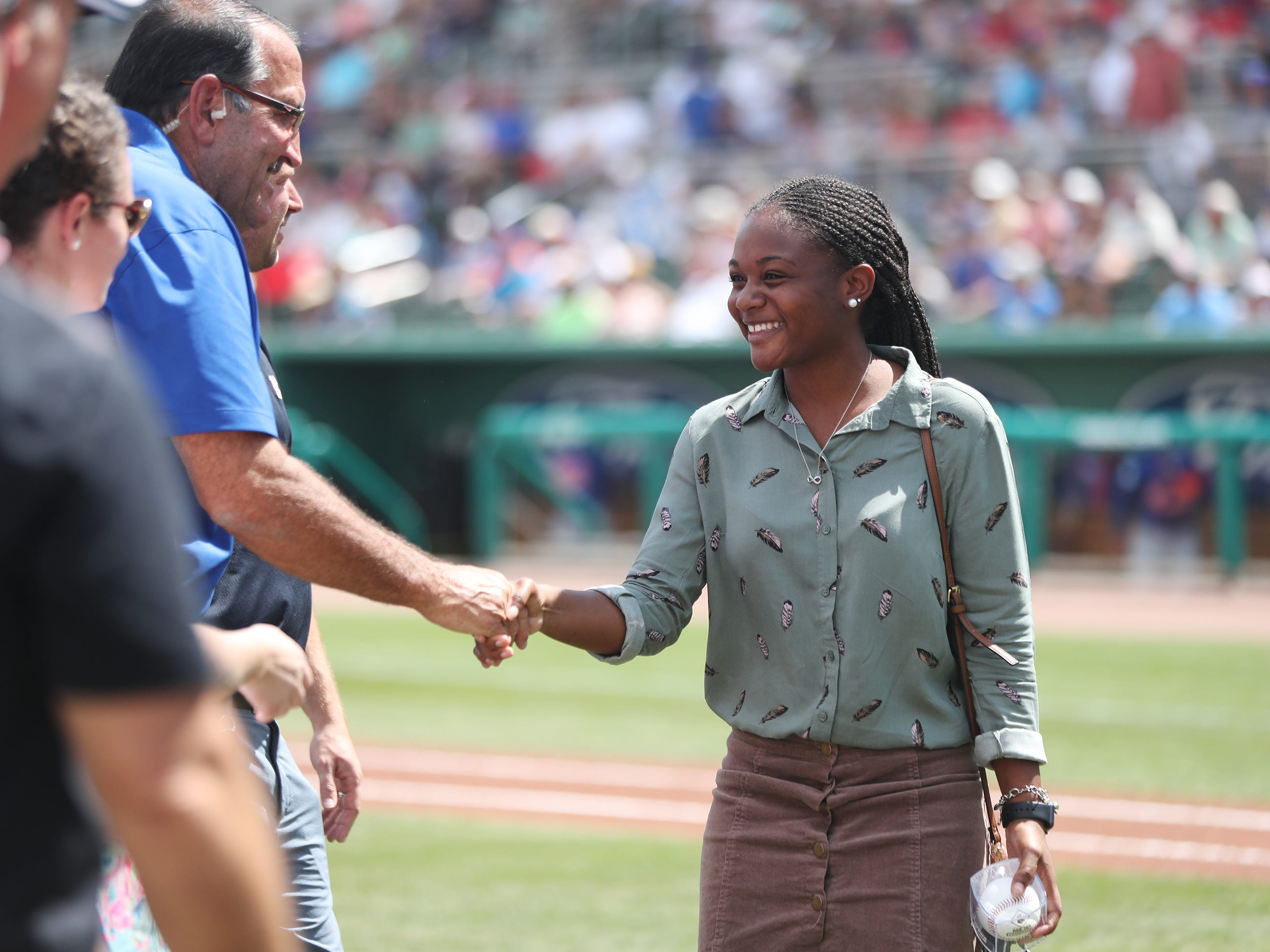 Dunbar High School's Kamari Walker was one of 13 Lee County public high school seniors that received a $5,000 scholarship from the Boston Red Sox Foundation on Saturday before the team's game against the New York Mets at JetBlue Park in Fort Myers. The students' academic achievements and community service efforts were the basis for the honor.