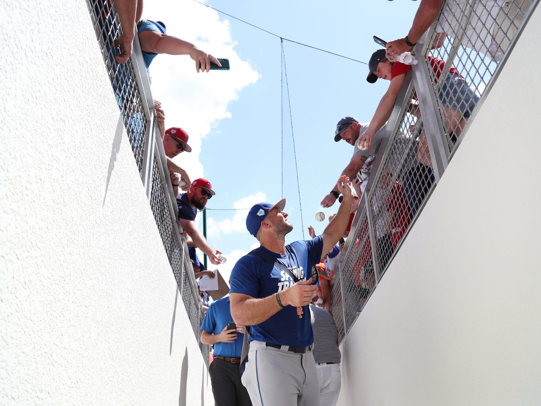 New York Mets' Tim Tebow greets fans before playing the Boston Red Sox on Saturday at JetBlue Park in Fort Myers.