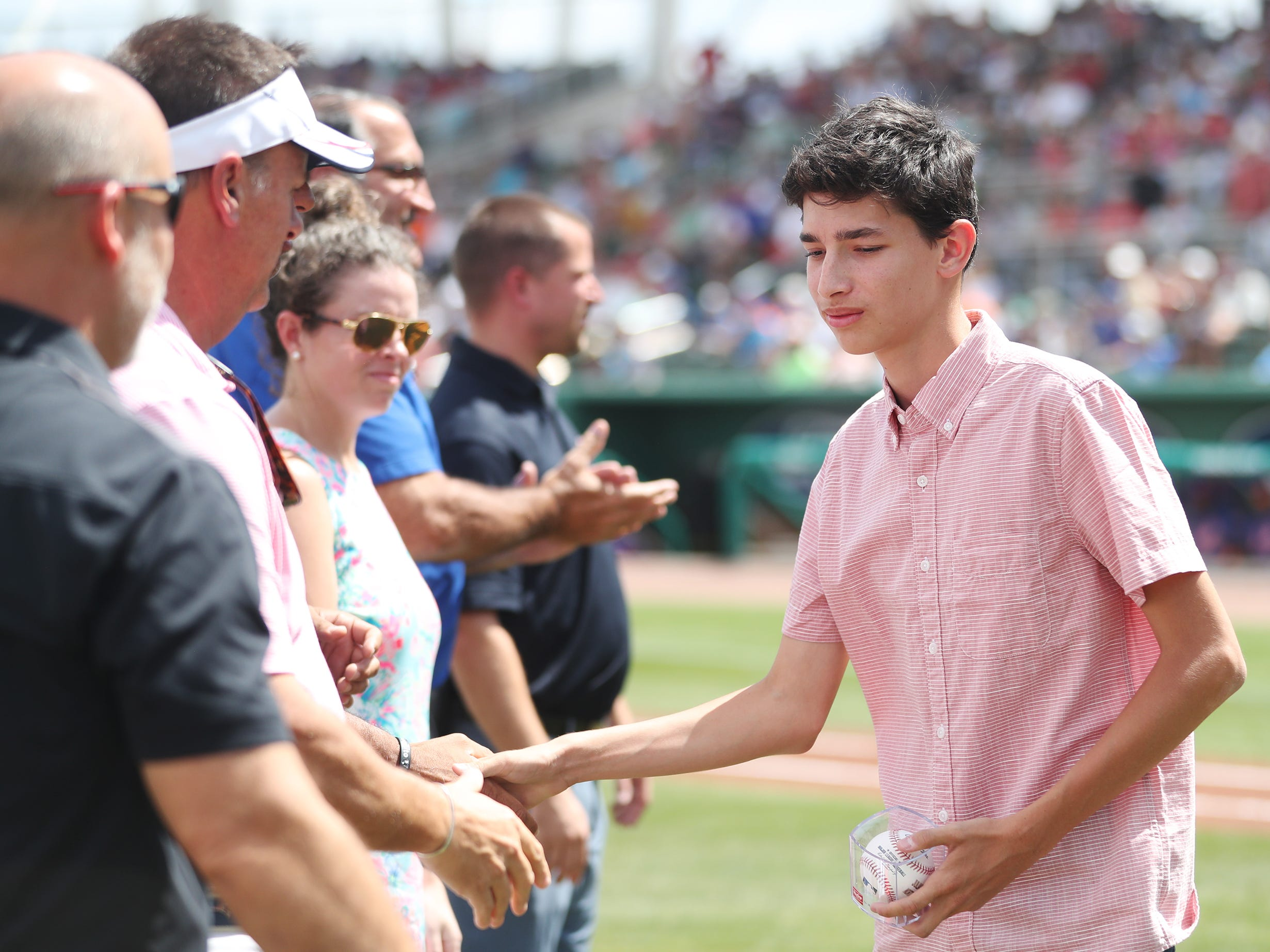 North Fort Myers High School's Julian Montoya was one of 13 Lee County public high school seniors that received a $5,000 scholarship from the Boston Red Sox Foundation on Saturday before the team's game against the New York Mets at JetBlue Park in Fort Myers. The students' academic achievements and community service efforts were the basis for the honor.