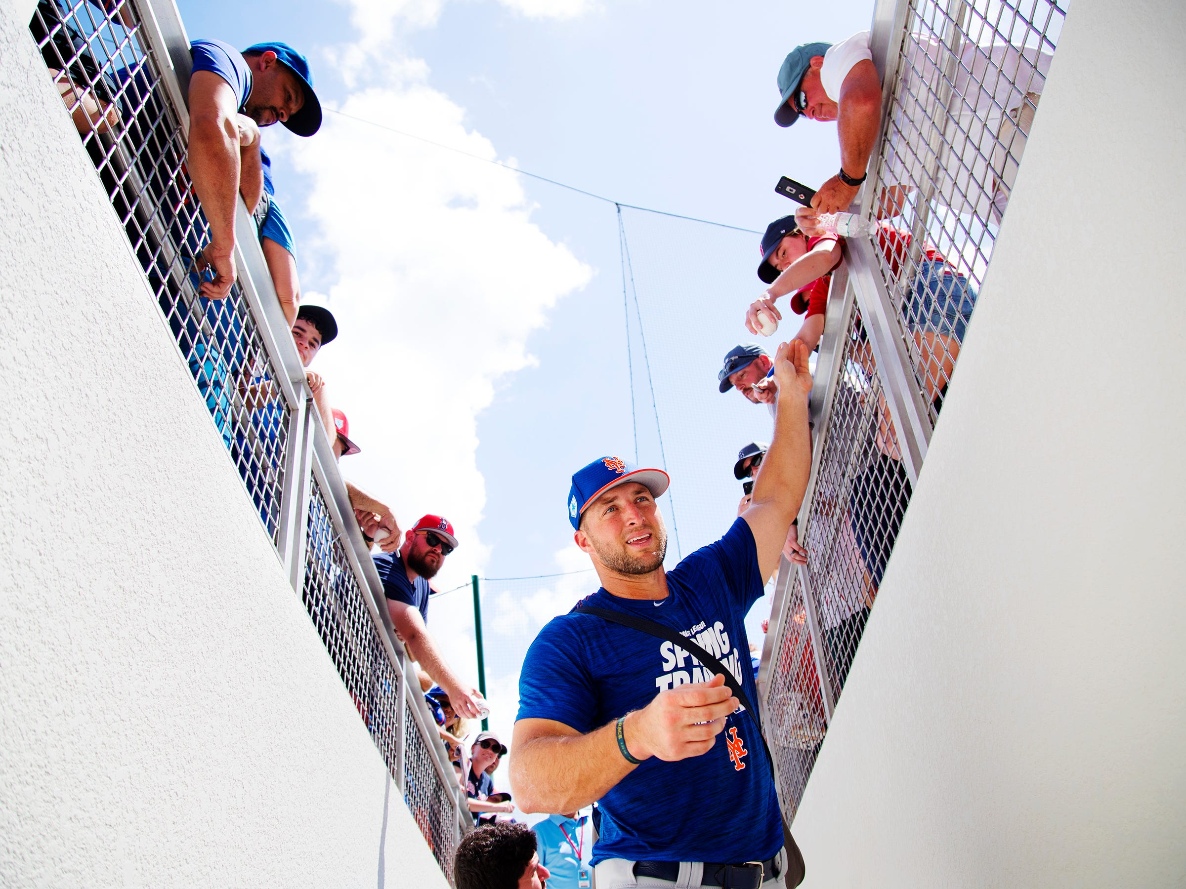 New York Mets' Tim Tebow greets fans before playing the Boston Red Sox on Saturday, March 9, 2019 at JetBlue Park in Fort Myers.
