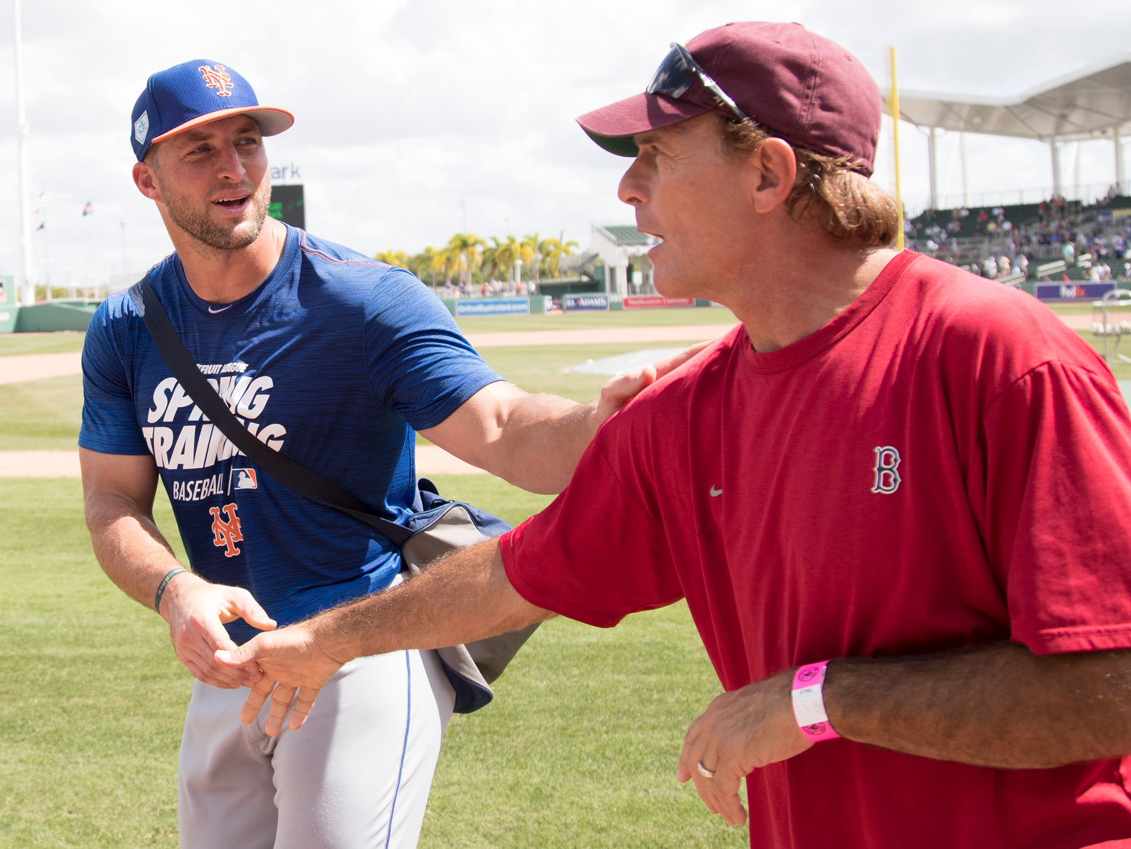 New York Mets' Tim Tebow meets fans before playing the Boston Red Sox on Saturday at JetBlue Park in Fort Myers.