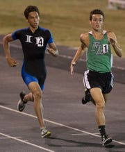 Ida Baker High School's Ryan Ringer, left, and Fort Myers' Nick Carpenter compete in the 800 meter race on Friday in the Edison Relays at Fort Myers High School.