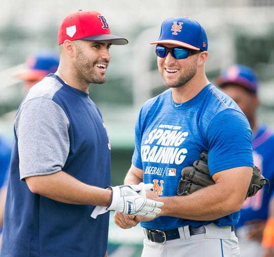 Boston Red Sox J.D. Martinez, left, and New York Mets' Tim Tebow relax before their spring training game on Saturday, March 9, 2019 at JetBlue Park in Fort Myers.