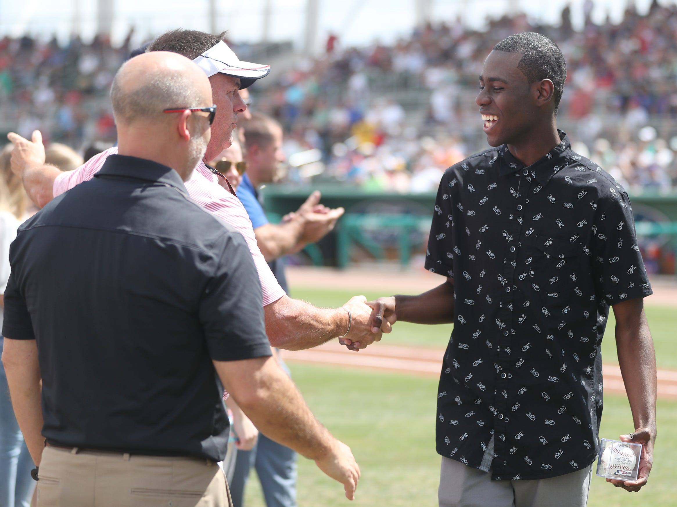 Riverdale High School's Natwayn Altema was one of 13 Lee County public high school seniors that received a $5,000 scholarship from the Boston Red Sox Foundation on Saturday before the team's game against the New York Mets at JetBlue Park in Fort Myers. The students' academic achievements and community service efforts were the basis for the honor.