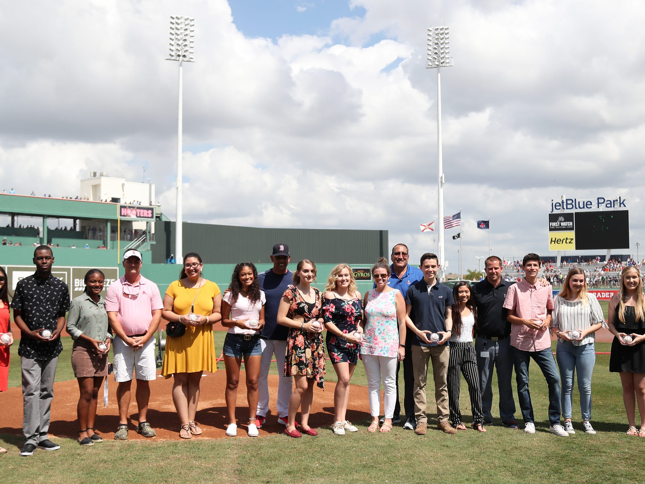 Thirteen Lee County public high school seniors each received a $5,000 scholarship from the Boston Red Sox Foundation on Saturday before the team's game against the New York Mets at JetBlue Park in Fort Myers. The students' academic achievements and community service efforts were the basis for the honor.