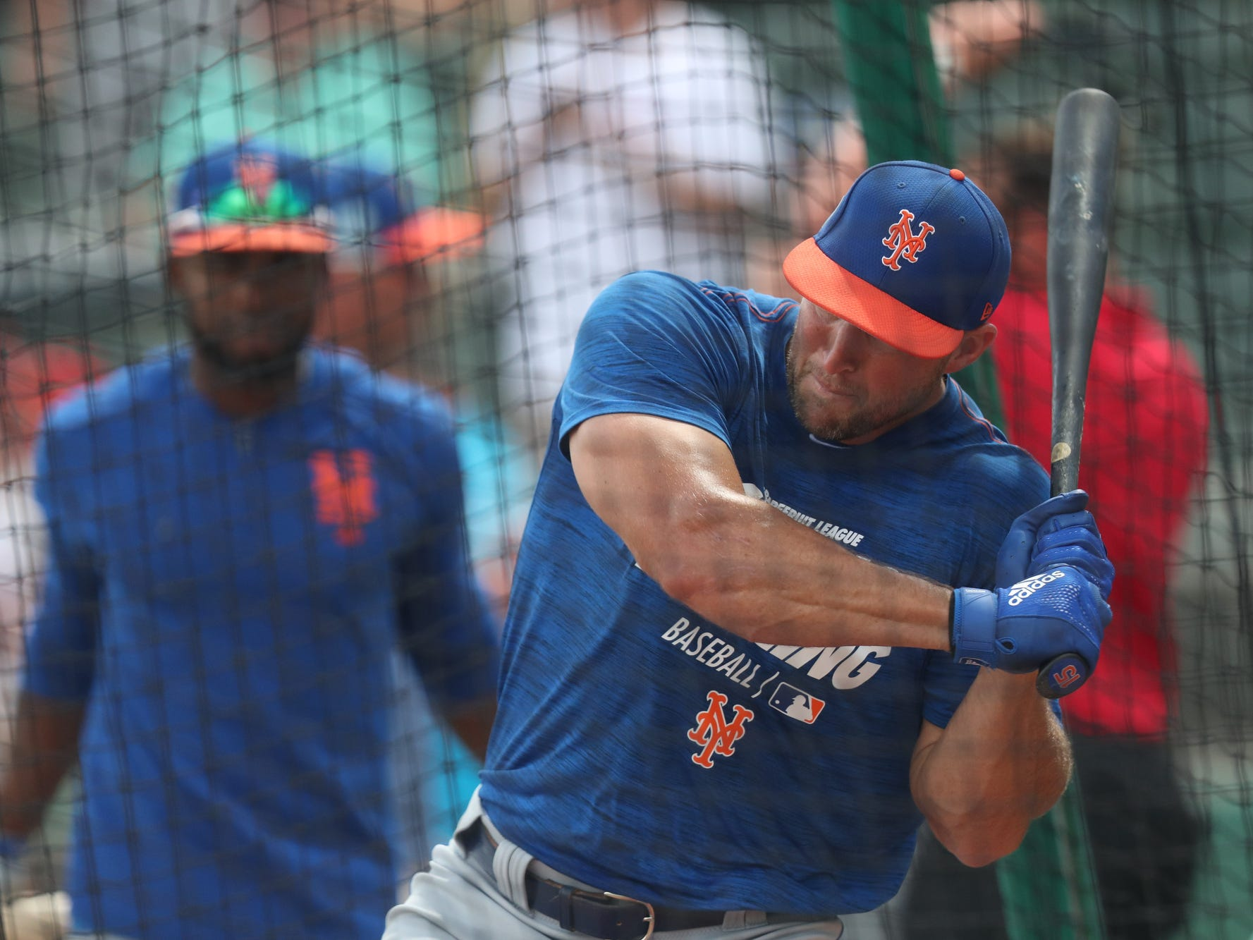 New York Mets' Tim Tebow warms up before playing the Boston Red Sox on Saturday at JetBlue Park in Fort Myers.