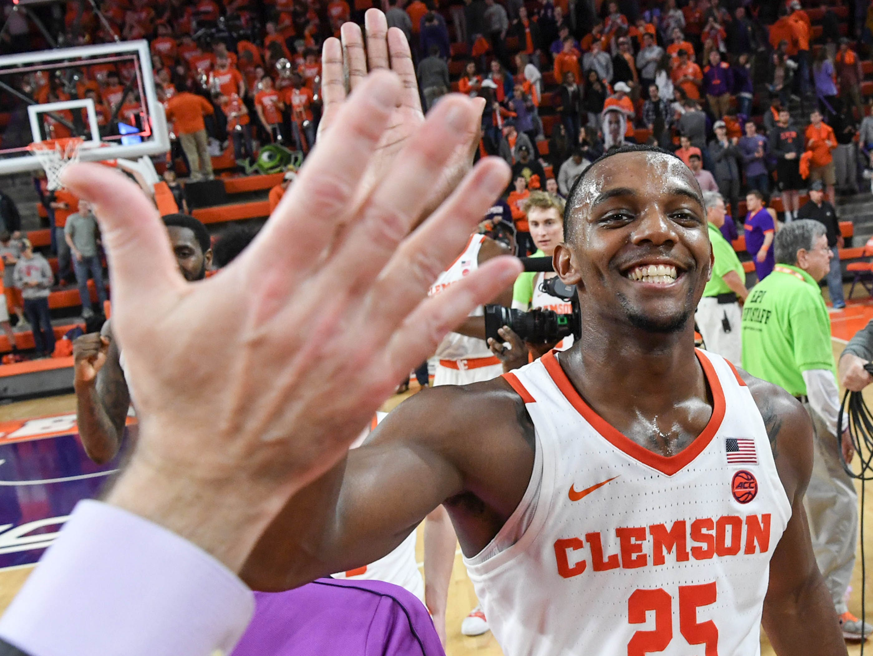 Clemson forward Aamir Simms (25) celebrates a 67-55 win over Syracuse in Littlejohn ColiseumSyracuse Saturday, March 9, 2019.