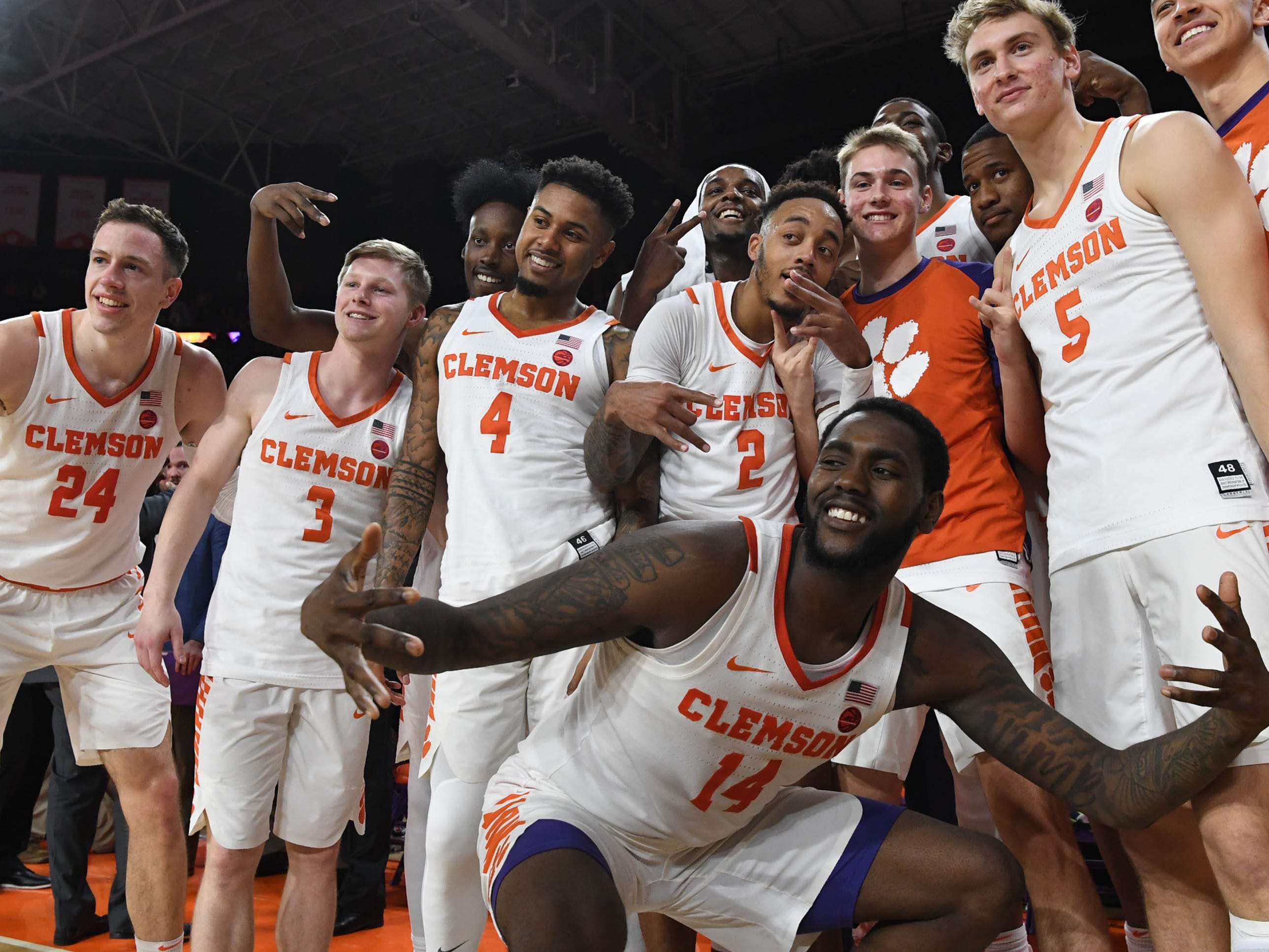 Clemson players celebrate after a 67-55 win over Syracuse in Littlejohn Coliseum in Clemson Saturday, March 9, 2019.