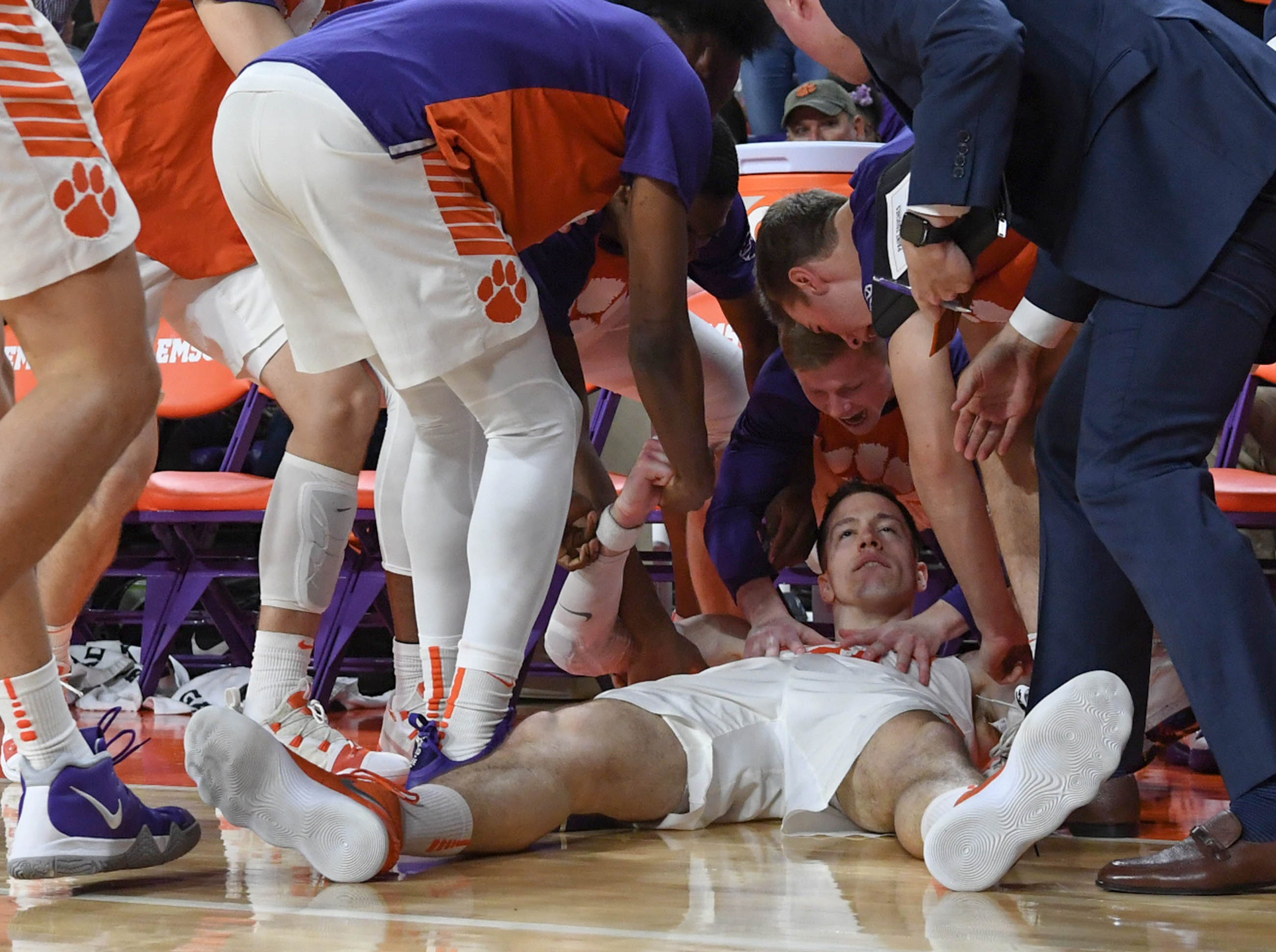 Clemson forward David Skara (24) is mobbed by teammates with 11:27 left during the second half in Littlejohn Coliseum in Clemson Saturday, March 9, 2019.