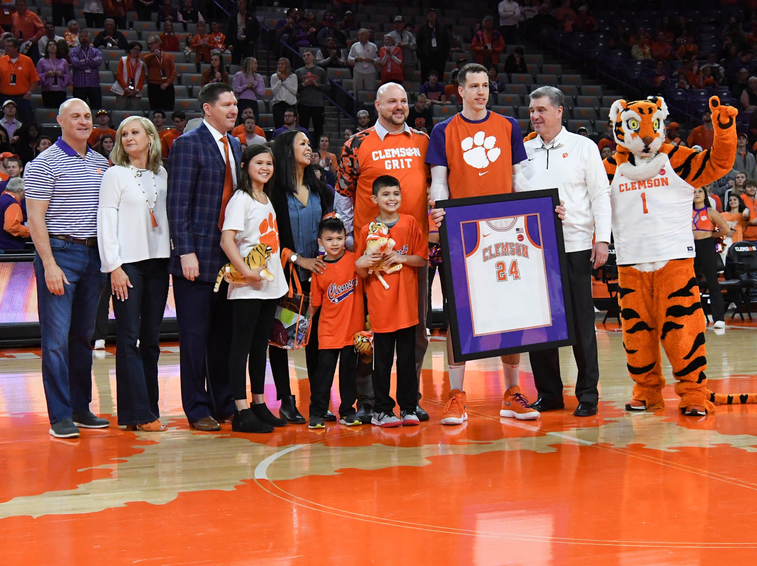 Clemson forward David Skara (24) poses with family as one of the five seniors honored before the game with Syracuse in Littlejohn Coliseum in Clemson Saturday, March 9, 2019.