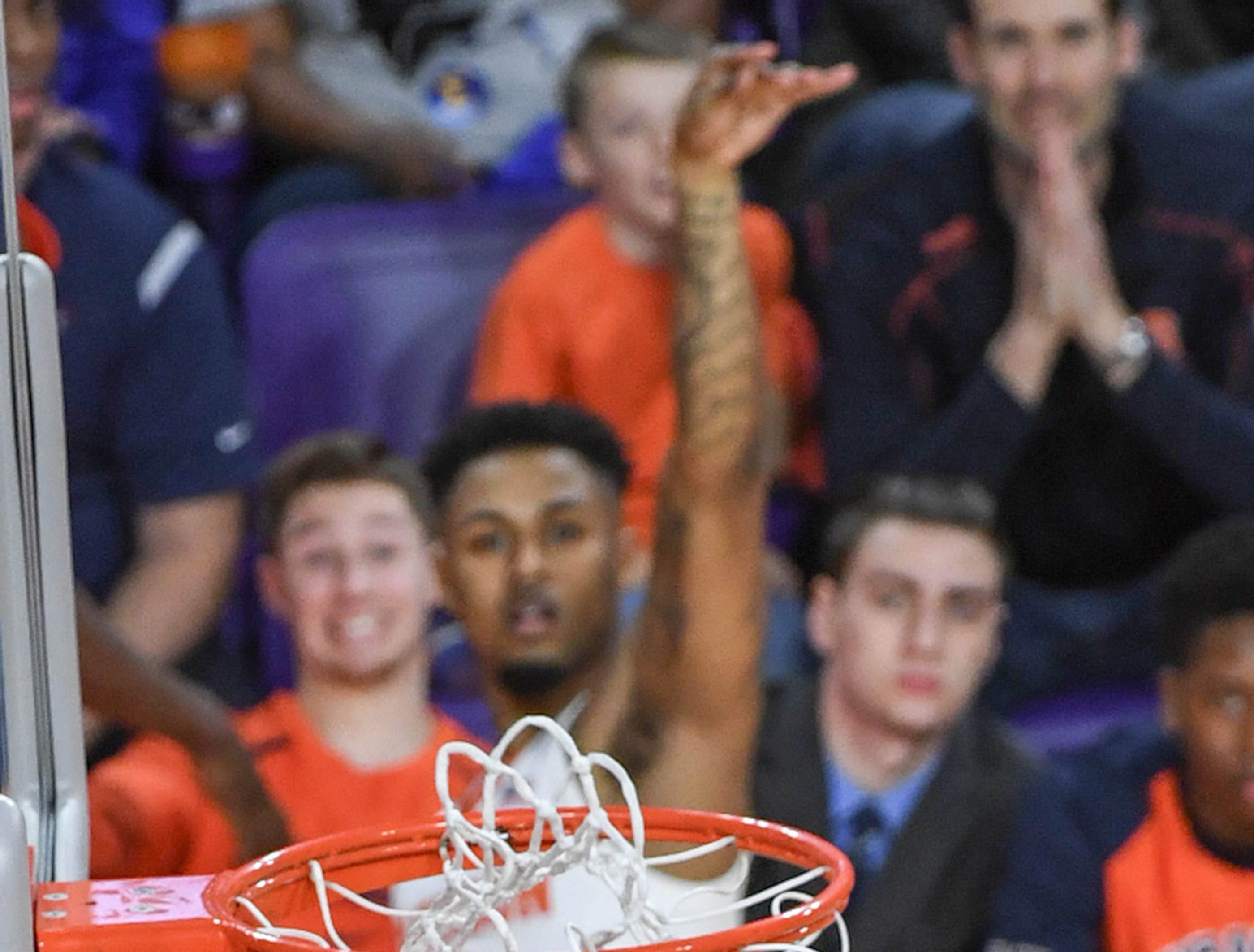 The ball hits all net, a three-pointer for Clemson guard Shelton Mitchell (4) during the first half in Littlejohn Coliseum in Clemson Saturday, March 9, 2019.