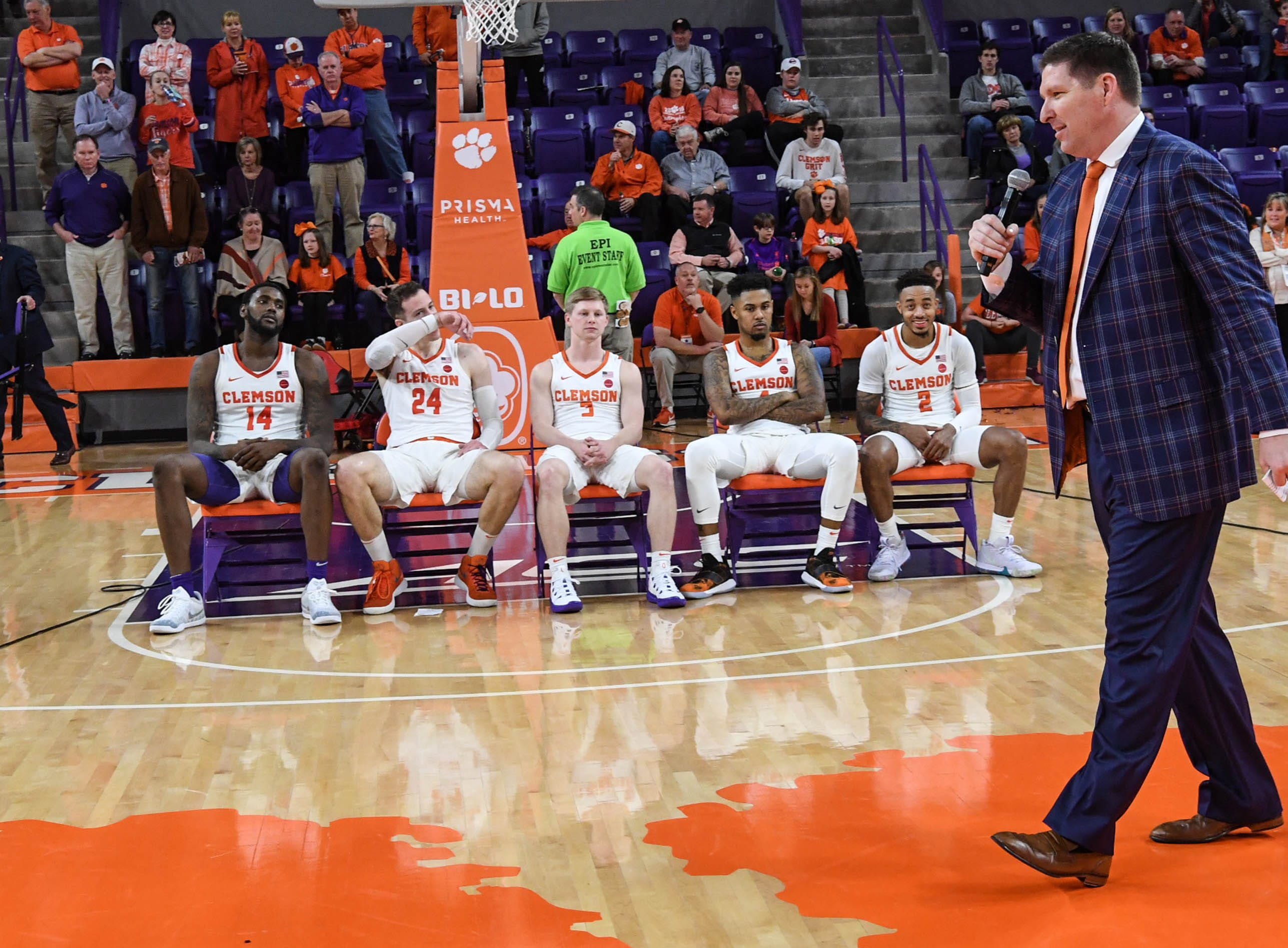 Clemson head coach Brad Brownell talks about his five seniors after a 67-55 win over Syracuse in Littlejohn Coliseum Saturday, March 9, 2019. From left, Clemson forward Elijah Thomas (14), forward David Skara (24), guard Lyles Davis (3), guard Shelton Mitchell (4), and guard Marcquise Reed (2) watch.