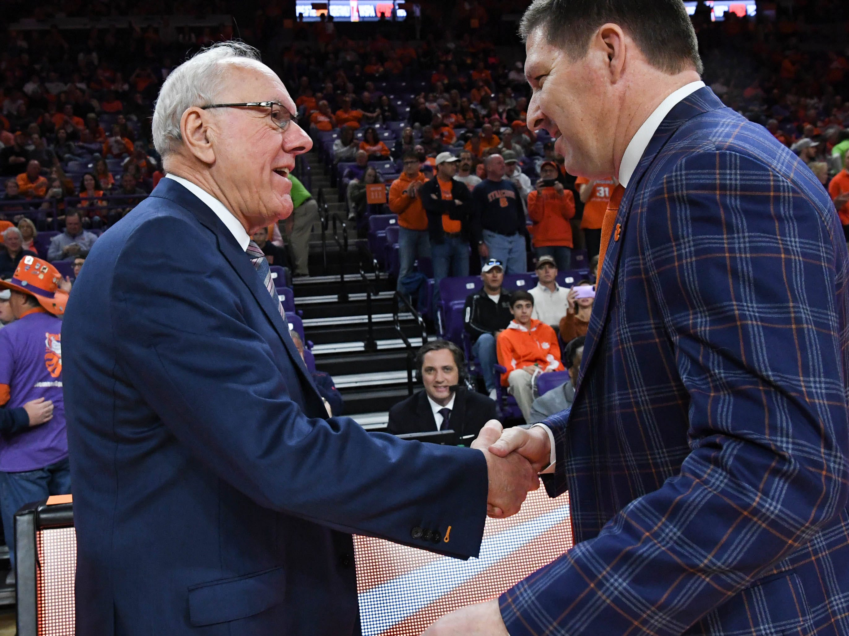 Syracuse head coach Jim Boeheim, left, and Clemson head coach Brad Brownell shake hands before the game against Syracuse Saturday, March 9, 2019.