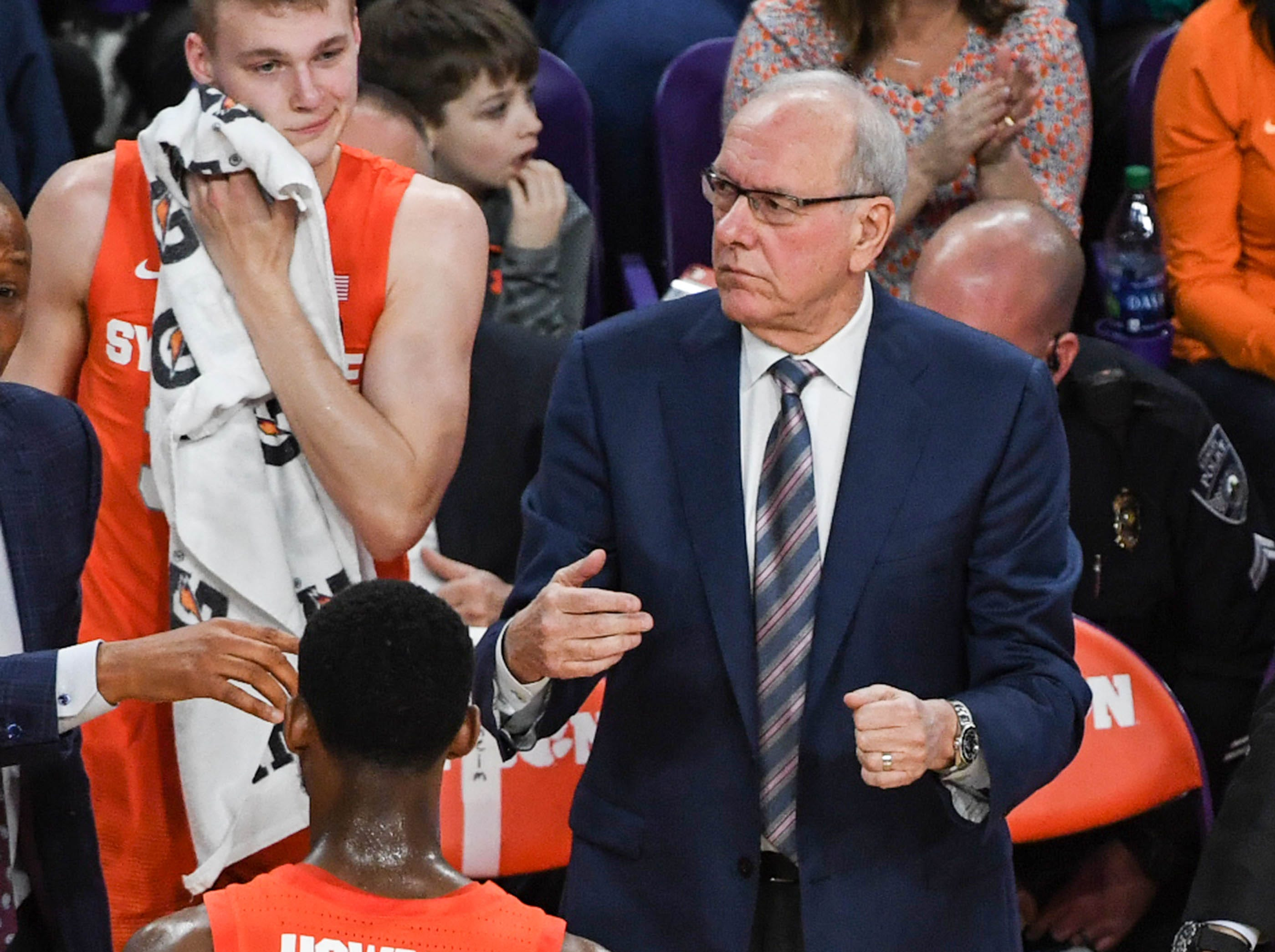 Syracuse head coach Jim Boeheim talks with players in a timeout during the first half in Littlejohn Coliseum in Clemson Saturday, March 9, 2019.