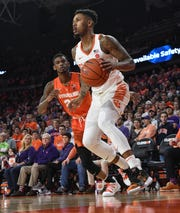 Clemson guard Shelton Mitchell (4) dribbles near Syracuse guard Frank Howard(23) during the first half in Littlejohn Coliseum in Clemson Saturday, March 9, 2019.