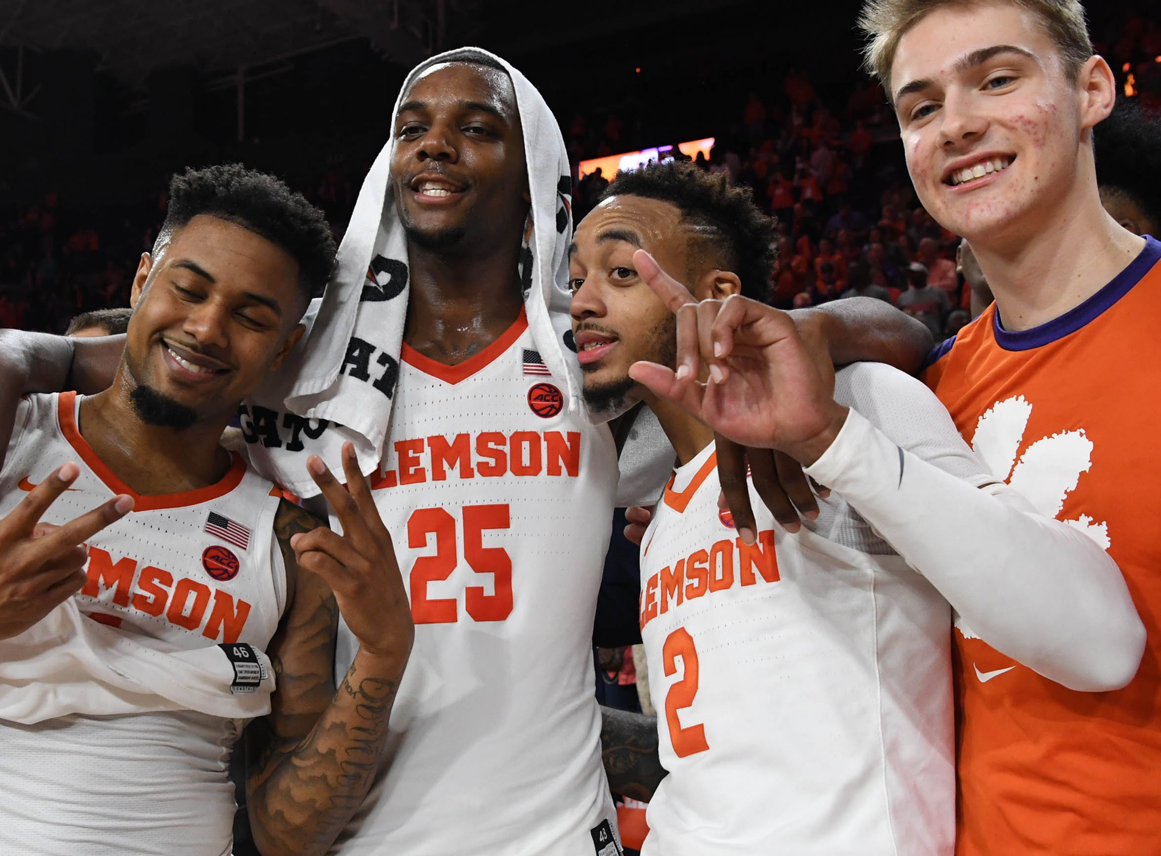 Clemson players Clemson guard Shelton Mitchell (4), forward Aamir Simms (25),guard Marcquise Reed (2), and forward Hunter Tyson(5) after a 67-55 win over Syracuse in Littlejohn Coliseum in Clemson Saturday, March 9, 2019.