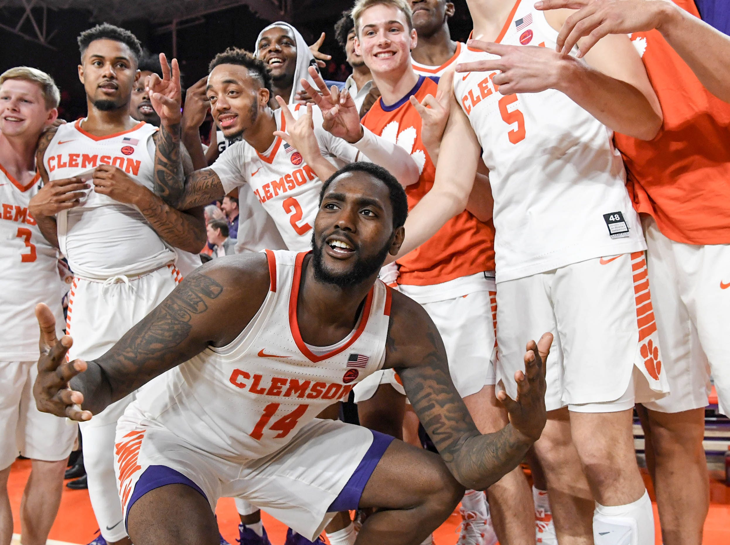 Clemson players celebrate a 67-55 win over Syracuse Saturday, March 9, 2019.