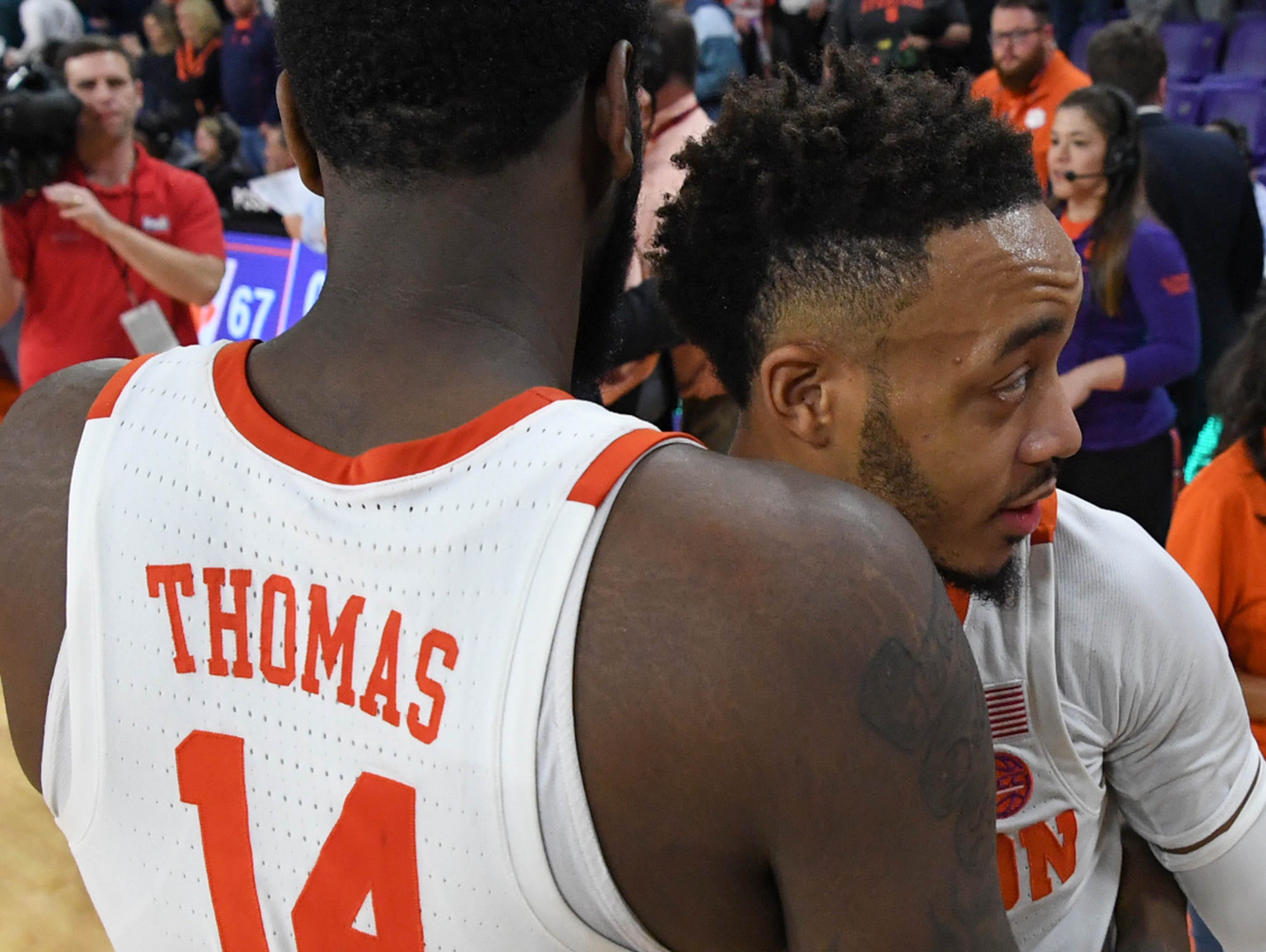 Clemson forward Elijah Thomas (14) and Clemson guard Marcquise Reed (2) after a 67-55 win over Syracuse in Littlejohn Coliseum in Clemson Saturday, March 9, 2019.