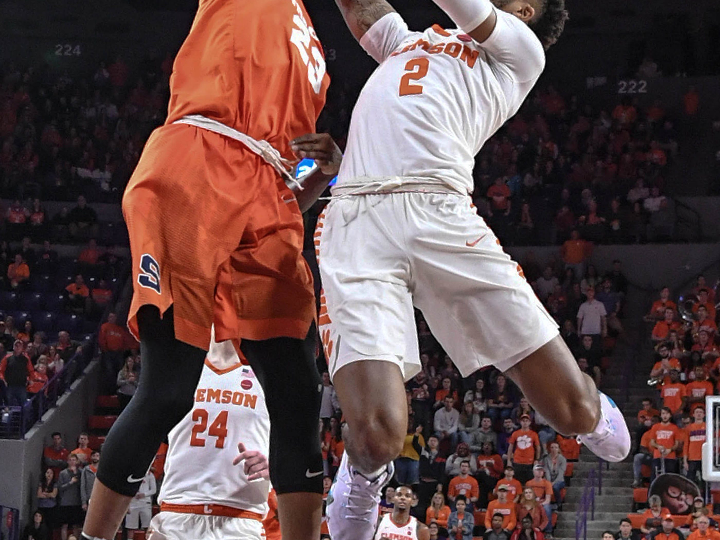 Clemson guard Marcquise Reed (2) shoots near Syracuse guard Frank Howard(23) during the second half in Littlejohn Coliseum in Clemson Saturday, March 9, 2019.