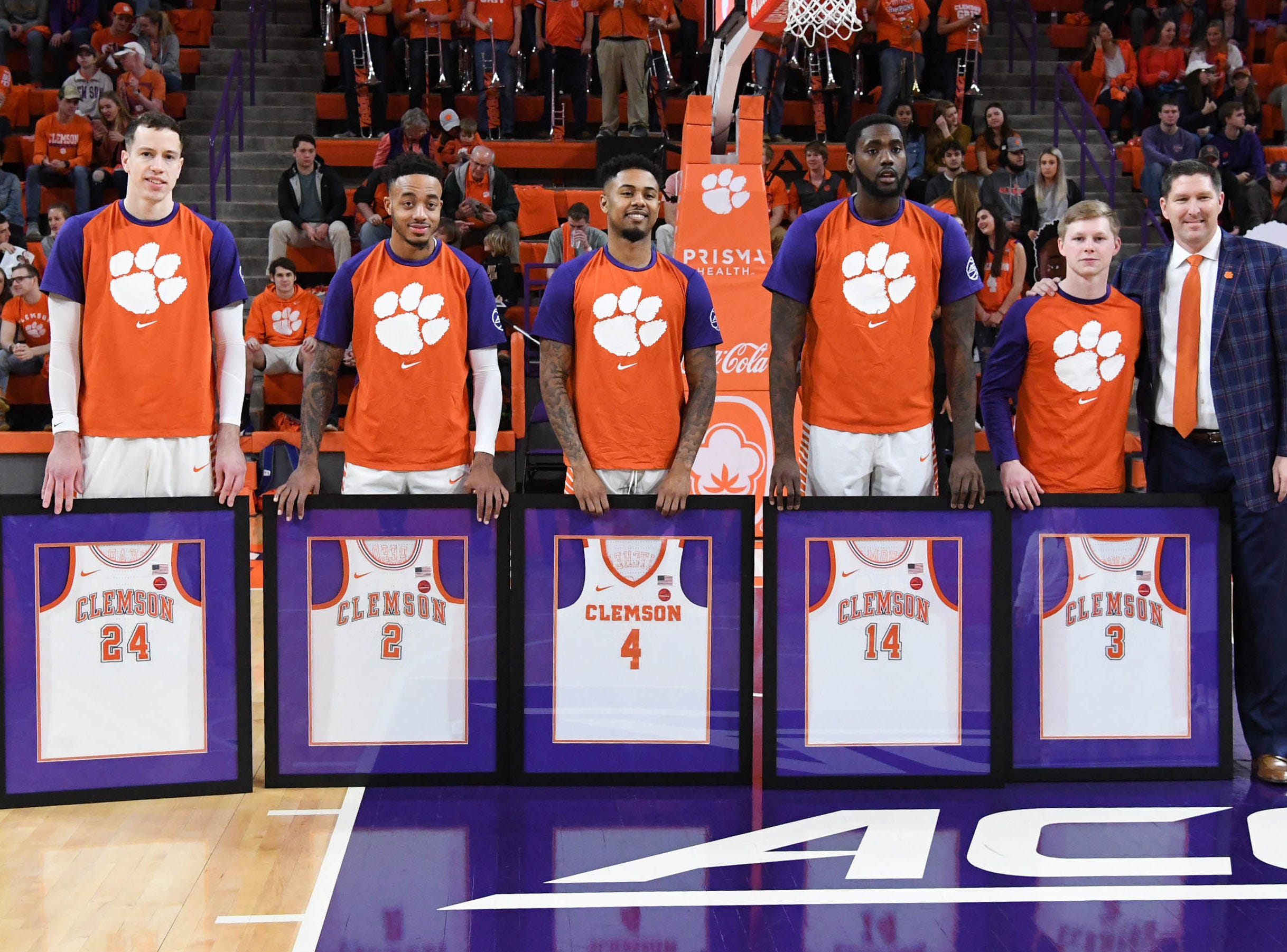 Clemson forward David Skara (24), Clemson guard Marcquise Reed (2), Clemson guard Shelton Mitchell (4), Clemson forward Elijah Thomas (14), and Clemson guard Lyles Davis (3) stand with Clemson head coach Brad Brownell honoring seniors before the game against Syracuse Saturday, March 9, 2019.
