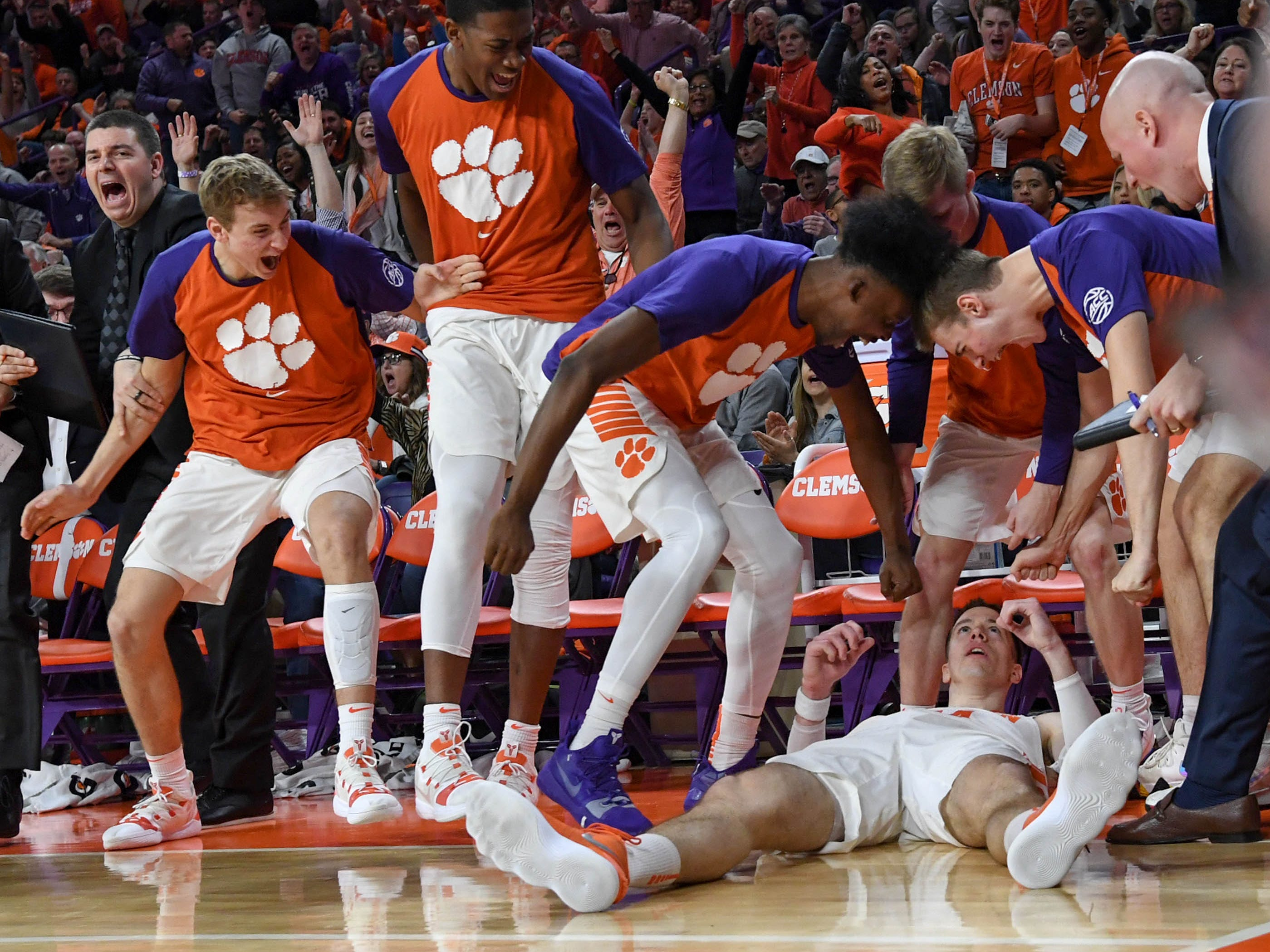 Clemson forward David Skara (24) is congratulated by teammates after making a basket and being fouled by Syracuse during the second half in Littlejohn Coliseum in Clemson Saturday, March 9, 2019.