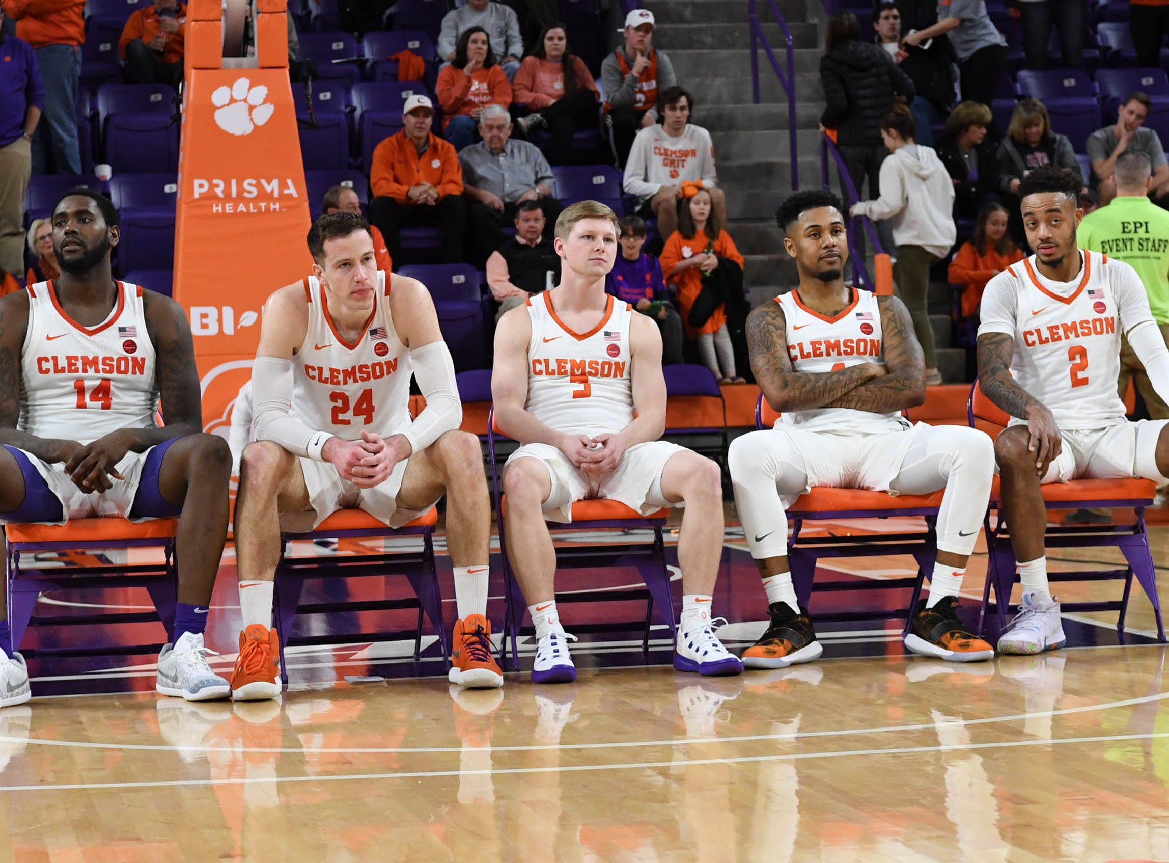 Clemson seniors, from left, forward Elijah Thomas (14), forward David Skara (24), guard Lyles Davis (3), guard Shelton Mitchell (4), and guard Marcquise Reed (2) are honored after the game against Syracuse Saturday, March 9, 2019.