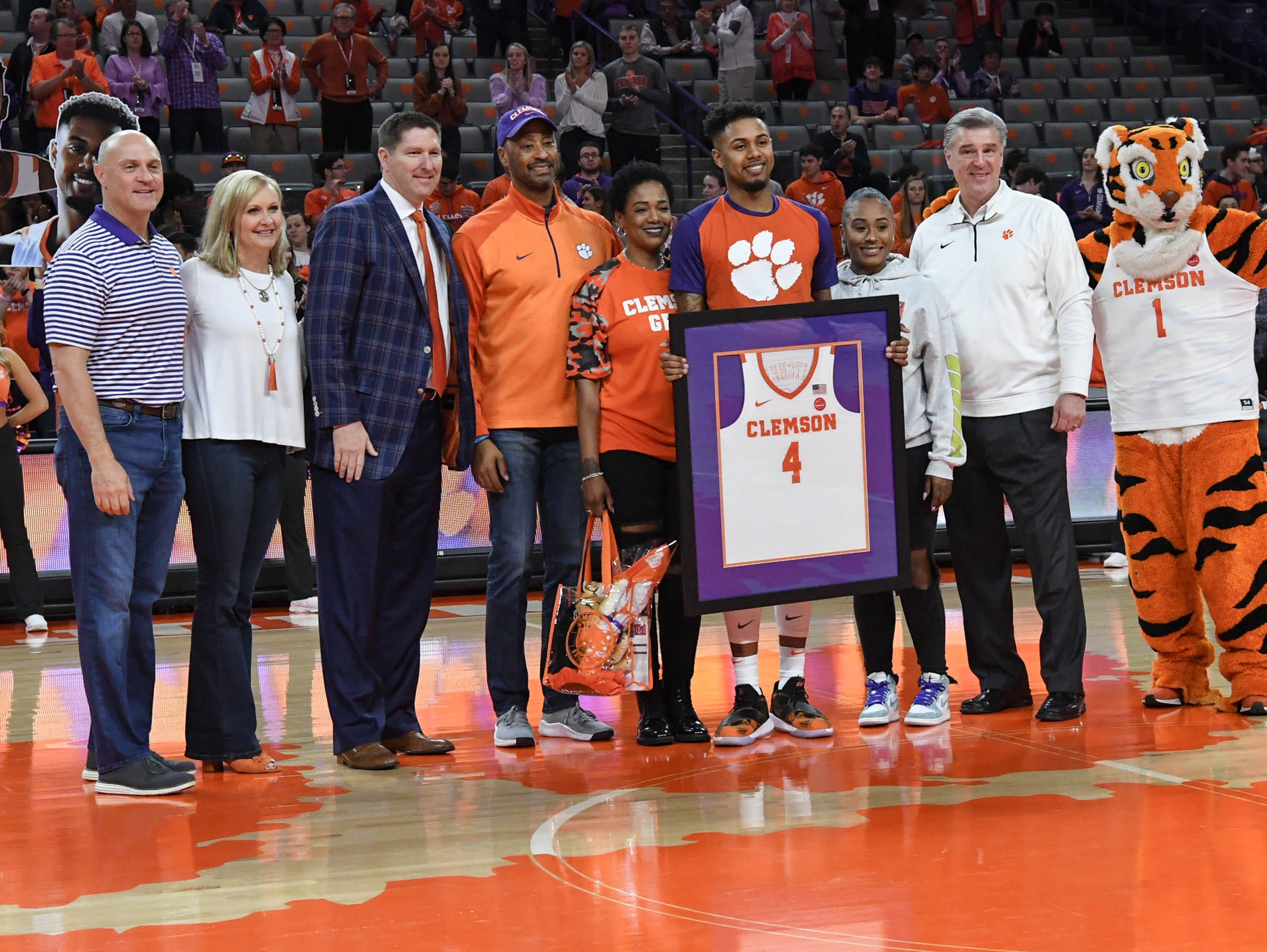 Clemson guard Shelton Mitchell (4) poses with family as one of the five seniors honored before the game with Syracuse in Littlejohn Coliseum in Clemson Saturday, March 9, 2019.